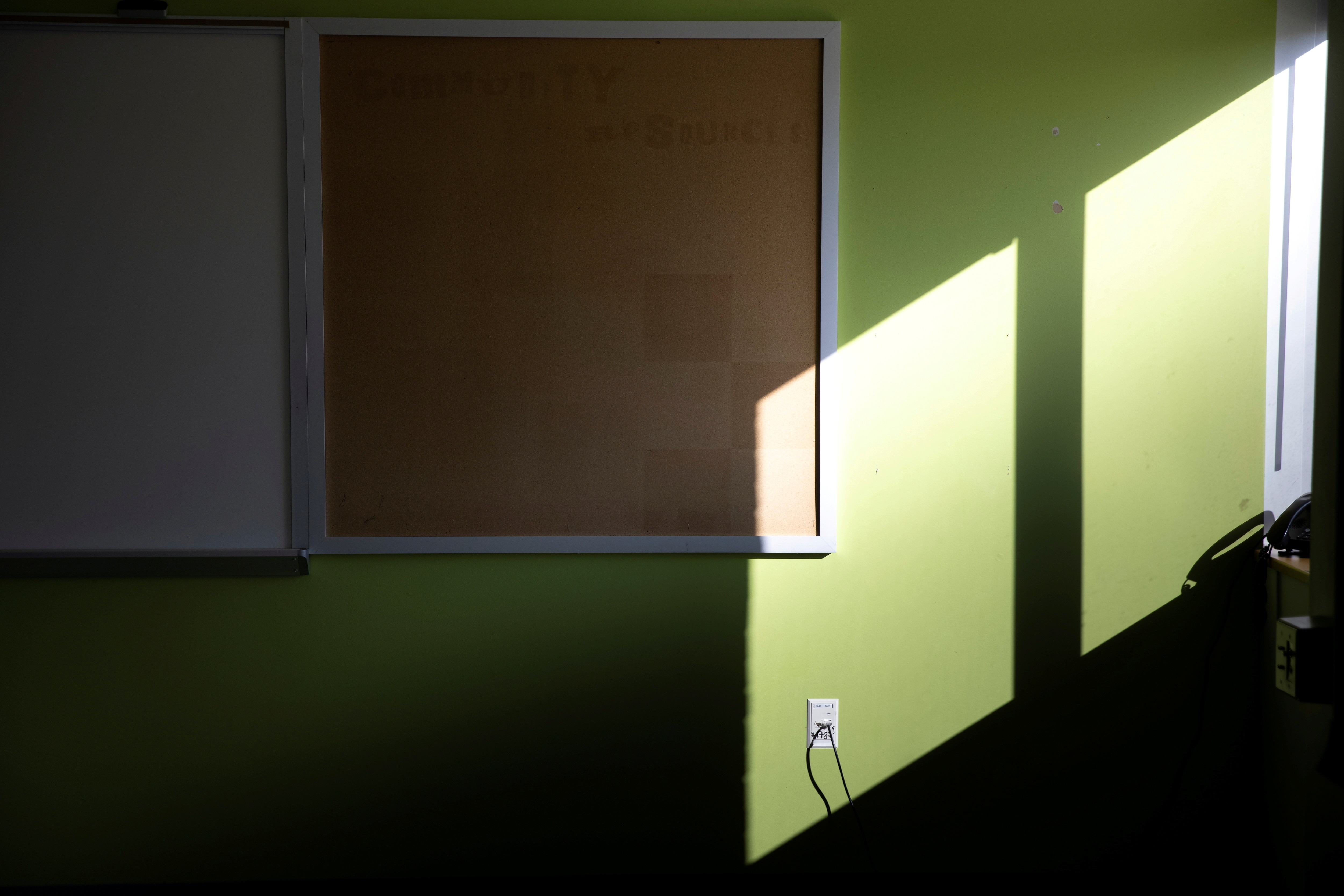 An empty tack board hangs inside a temporary isolation room ahead of in-person learning, amid the coronavirus disease (COVID-19) pandemic, at the Jefferson-Houston School in Alexandria, Virginia, U.S., February 23, 2021. REUTERS/Tom Brenner     TPX IMAGES OF THE DAY - RC2PYL9L62Z5