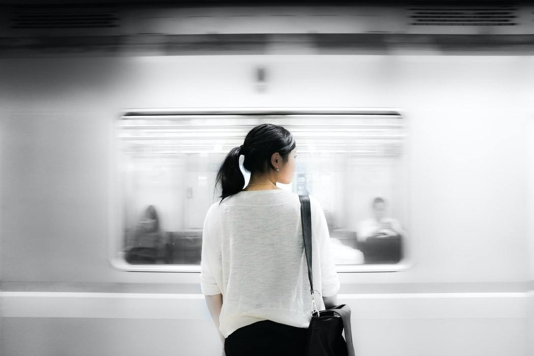 image of a woman waiting for the tube