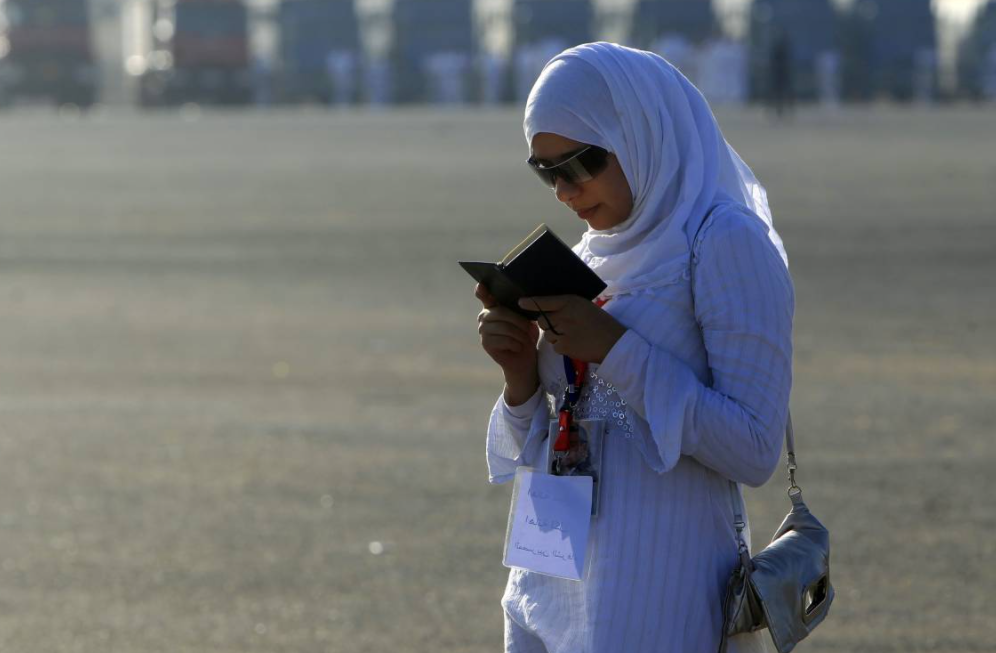 a woman reads the Koran in Cairo