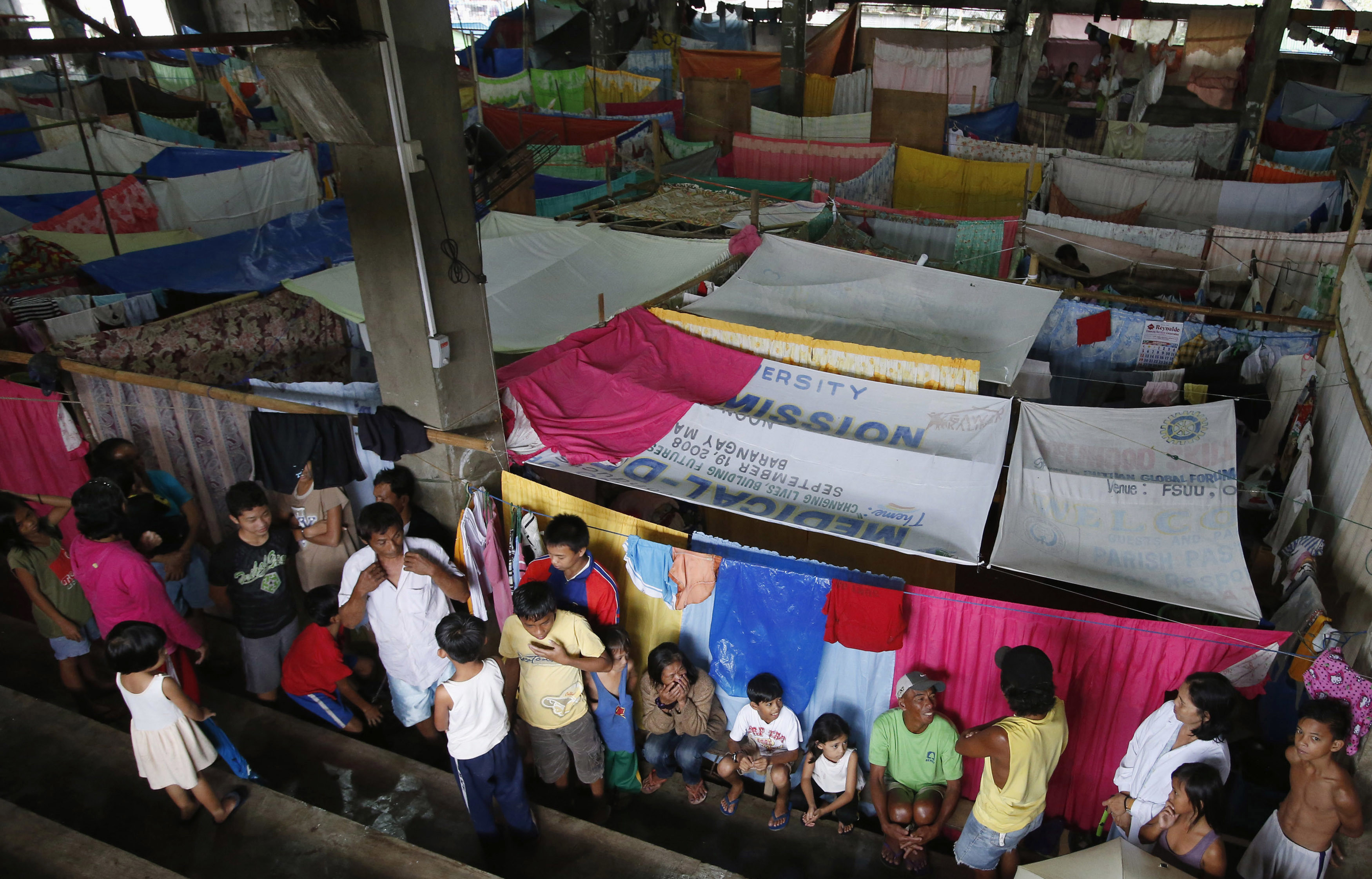 Residents who evacuated their homes due to flooding, in makeshift shelters on Mindanao