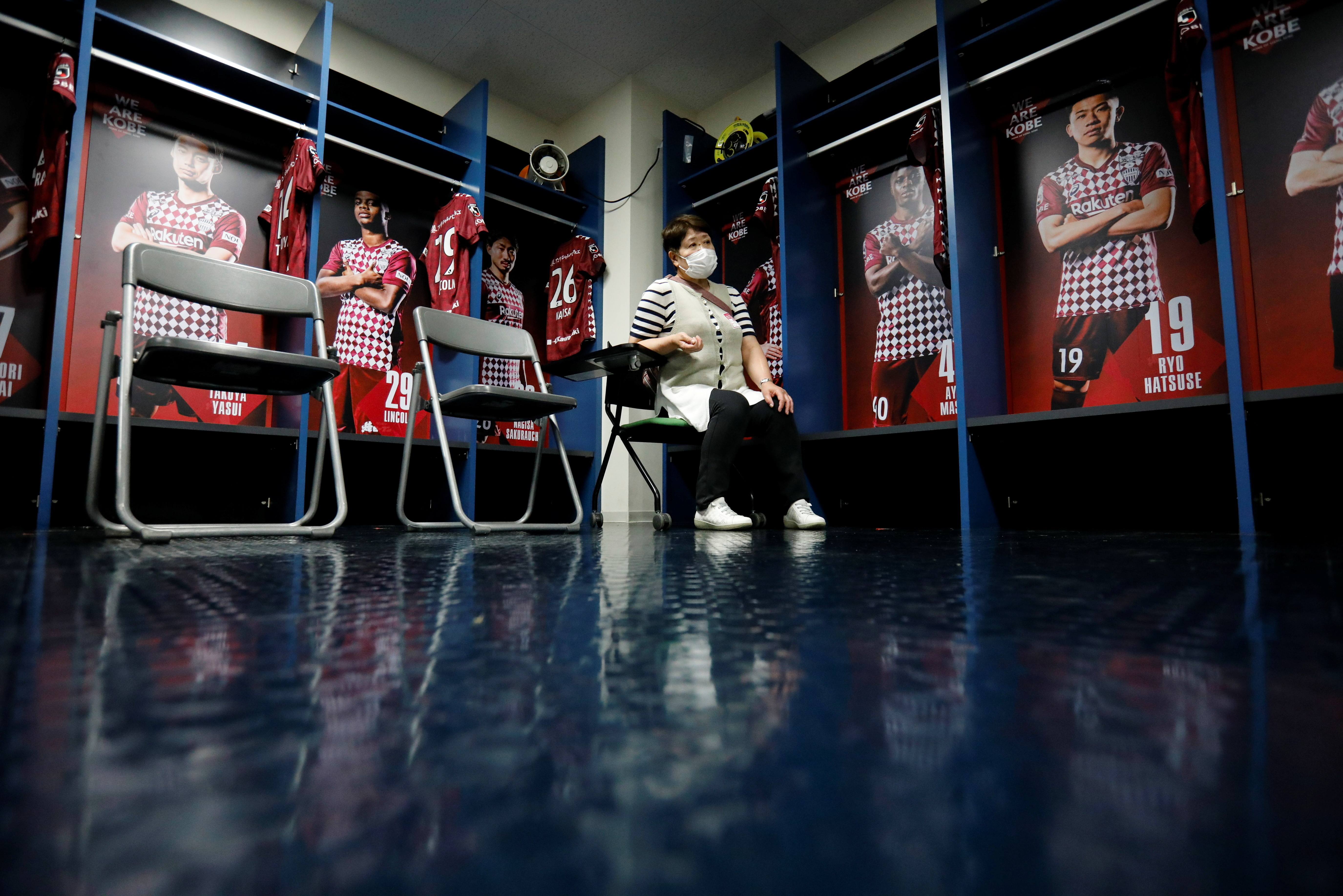 A woman waits for consultation after receiving a dose of the coronavirus disease (COVID-19) vaccine at the players' locker room of Japanese professional soccer club Vissel Kobe inside the Noevir Stadium Kobe, currently acting as a large-scale COVID-19 vaccination center, in Kobe, Japan June 12, 2021.  REUTERS/Issei Kato - RC2QYN9IYCCO