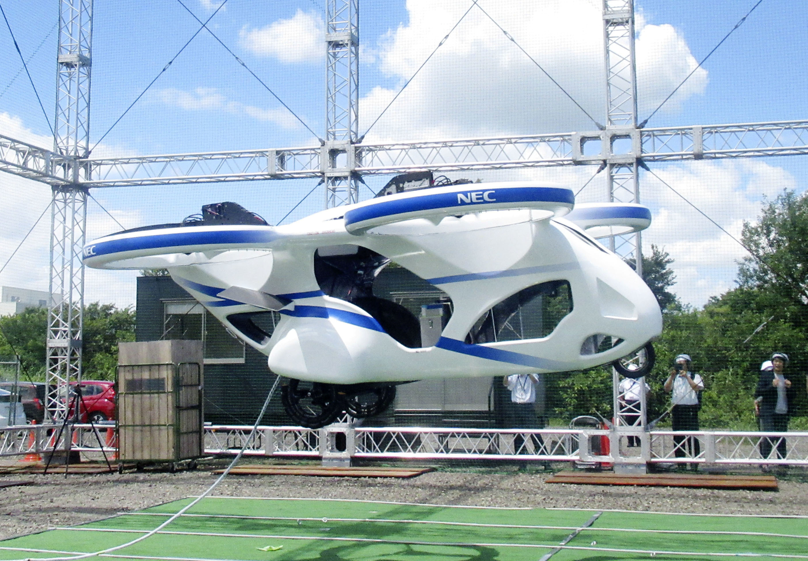 Japanese electronics maker NEC Corp. unveils a prototype of an electric flying car in Abiko, Chiba Prefecture, Japan, August 5, 2019. Picture taken August 5, 2019.  Mandatory credit Kyodo/via REUTERS ATTENTION EDITORS - THIS IMAGE WAS PROVIDED BY A THIRD PARTY. MANDATORY CREDIT. JAPAN OUT. NO COMMERCIAL OR EDITORIAL SALES IN JAPAN. - RC1D23074D10