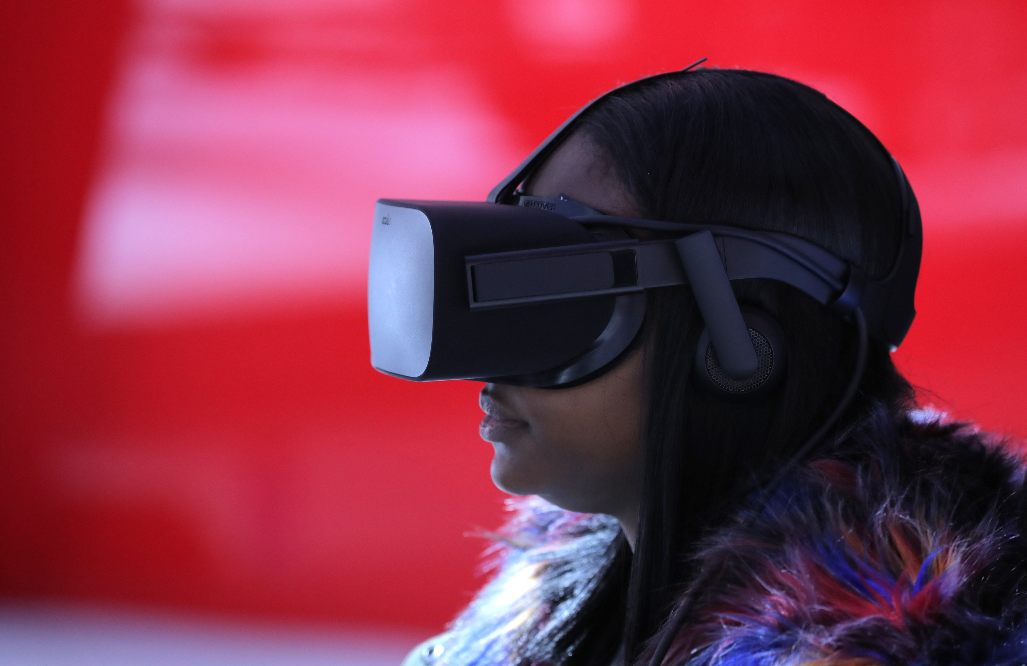 image of a woman wearing a virtual reality headset