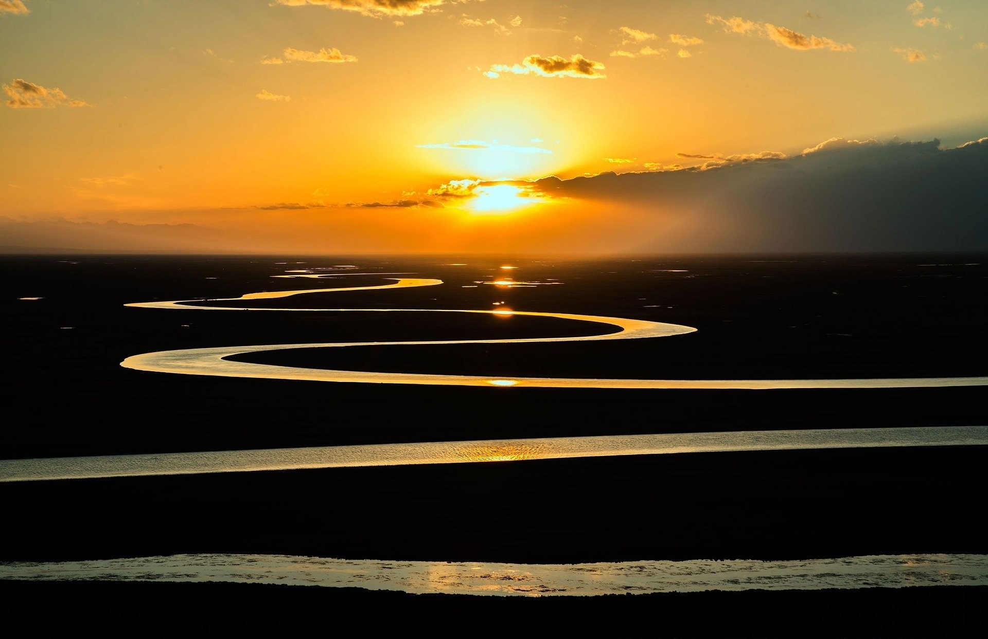 Curving river at sunset