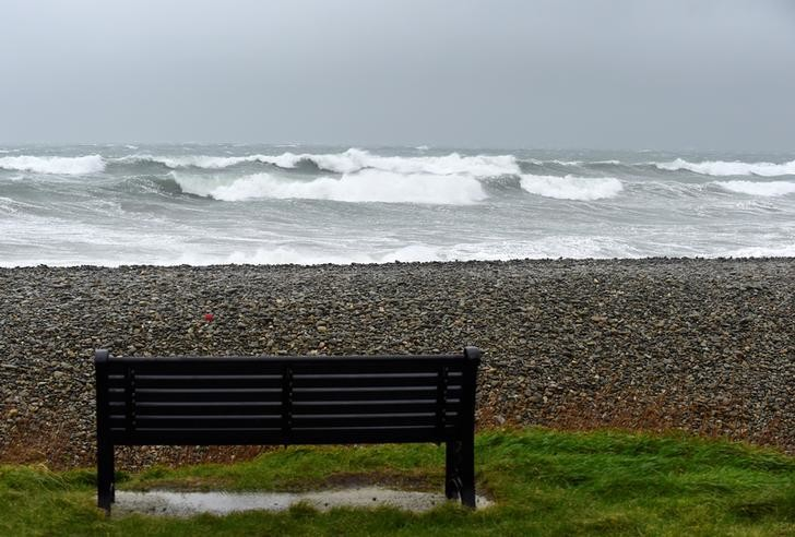 An empty bench near the rough seas at Newgale, Pembrokeshire, South Wales, Britain, February 15, 2020. REUTERS/Rebecca Naden