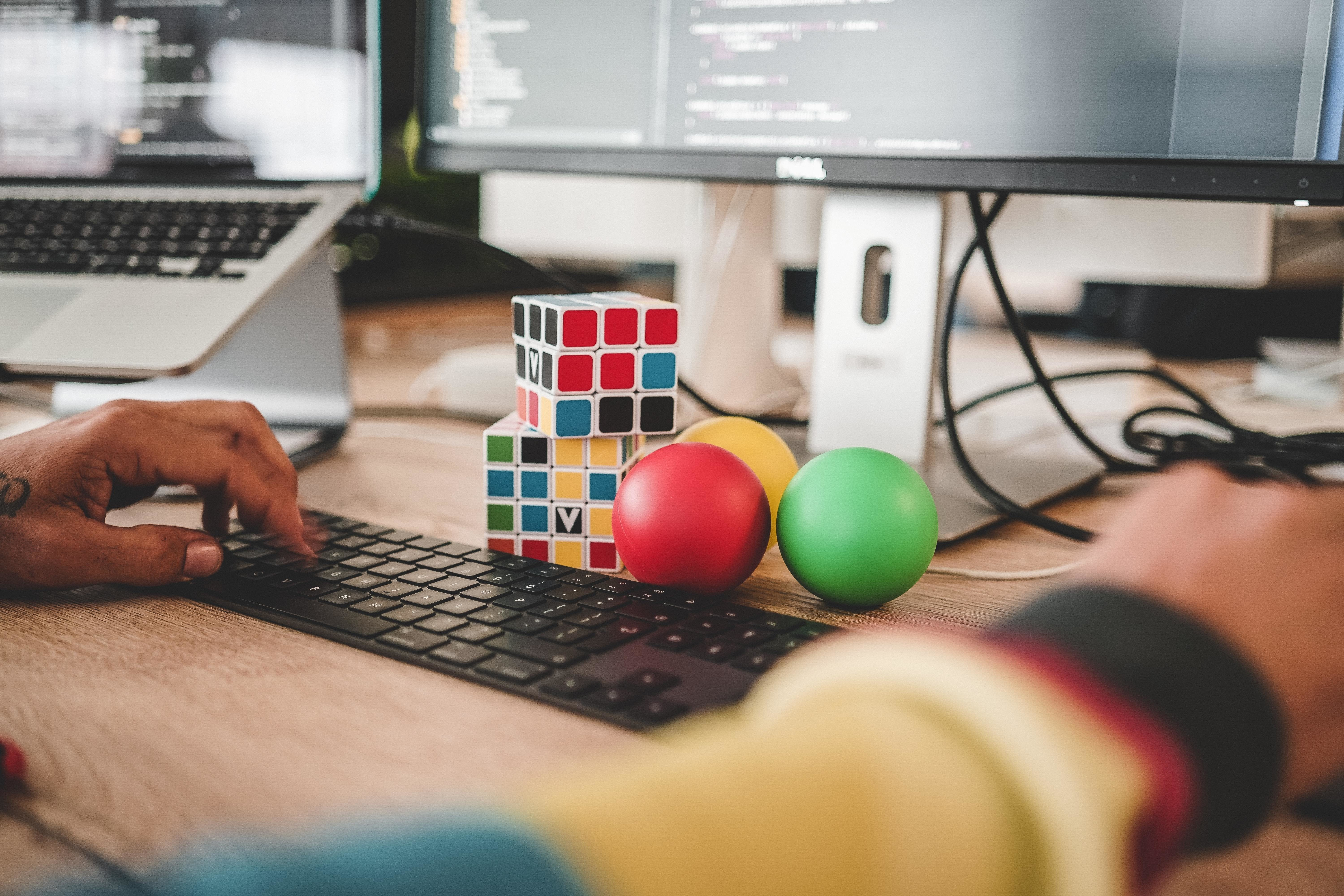 a picture of a desk with a puzzle toy on it