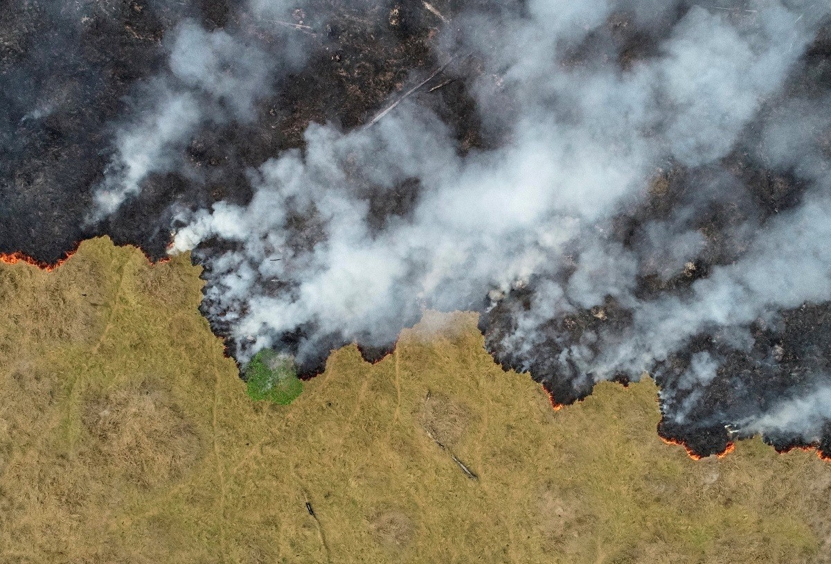 An aerial view shows smoke rising over a deforested plot of the Amazon jungle in Porto Velho, Rondonia State, Brazil, in this August 24, 2019 picture taken with a drone. Picture taken August 24, 2019. REUTERS/Ueslei Marcelino     TPX IMAGES OF THE DAY - RC180A432CE0
