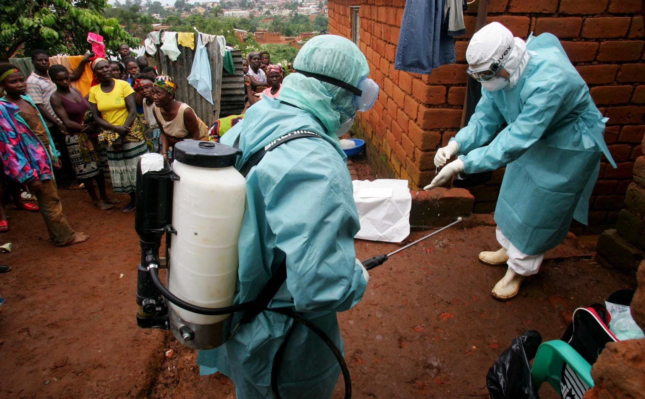 World Health Organisation officials dressed in PPE examine the home of a suspected Marburg virus victim