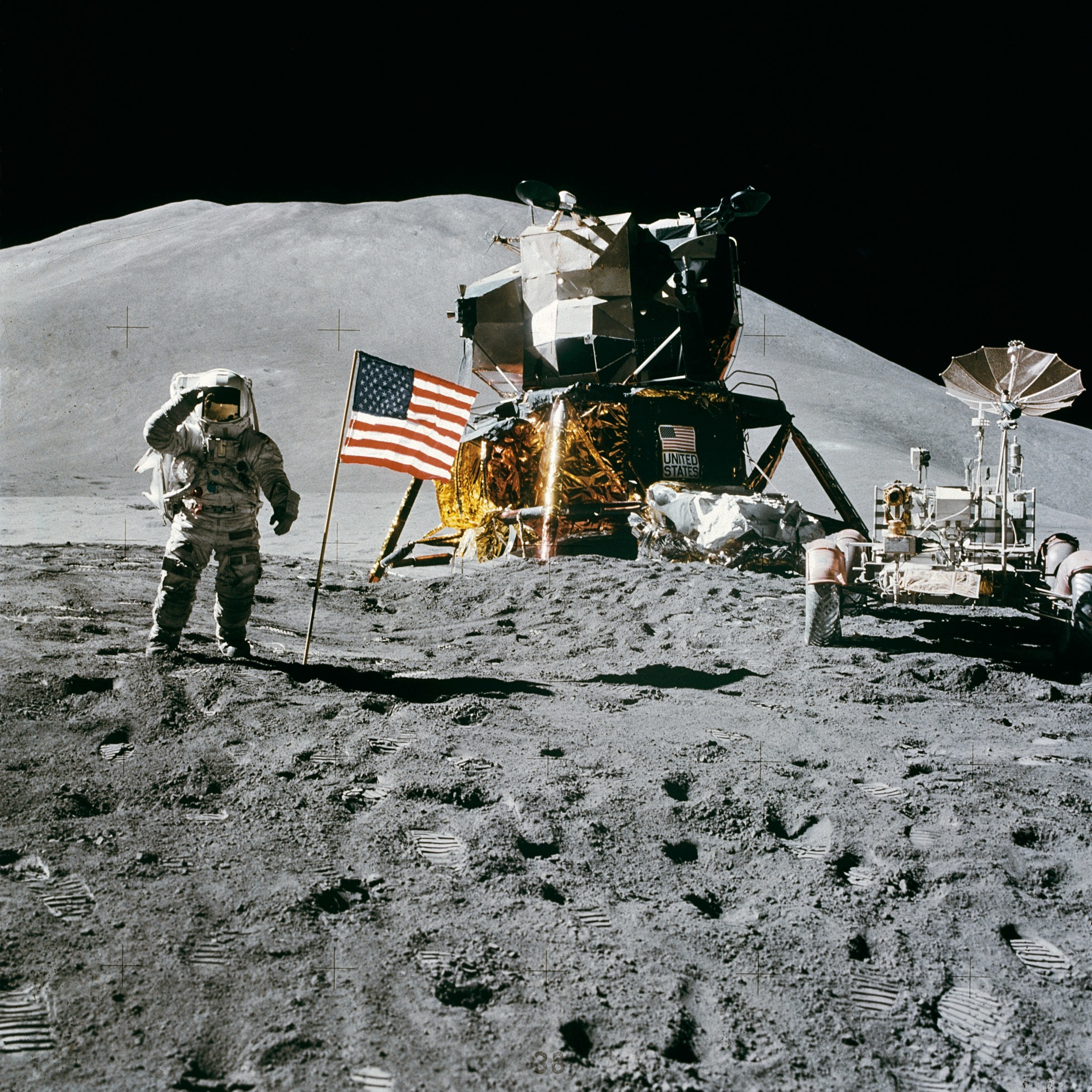 a picture of the moon landing - with the lunar module, american flag and James Irwin saluting during the Apollo 15 mission.