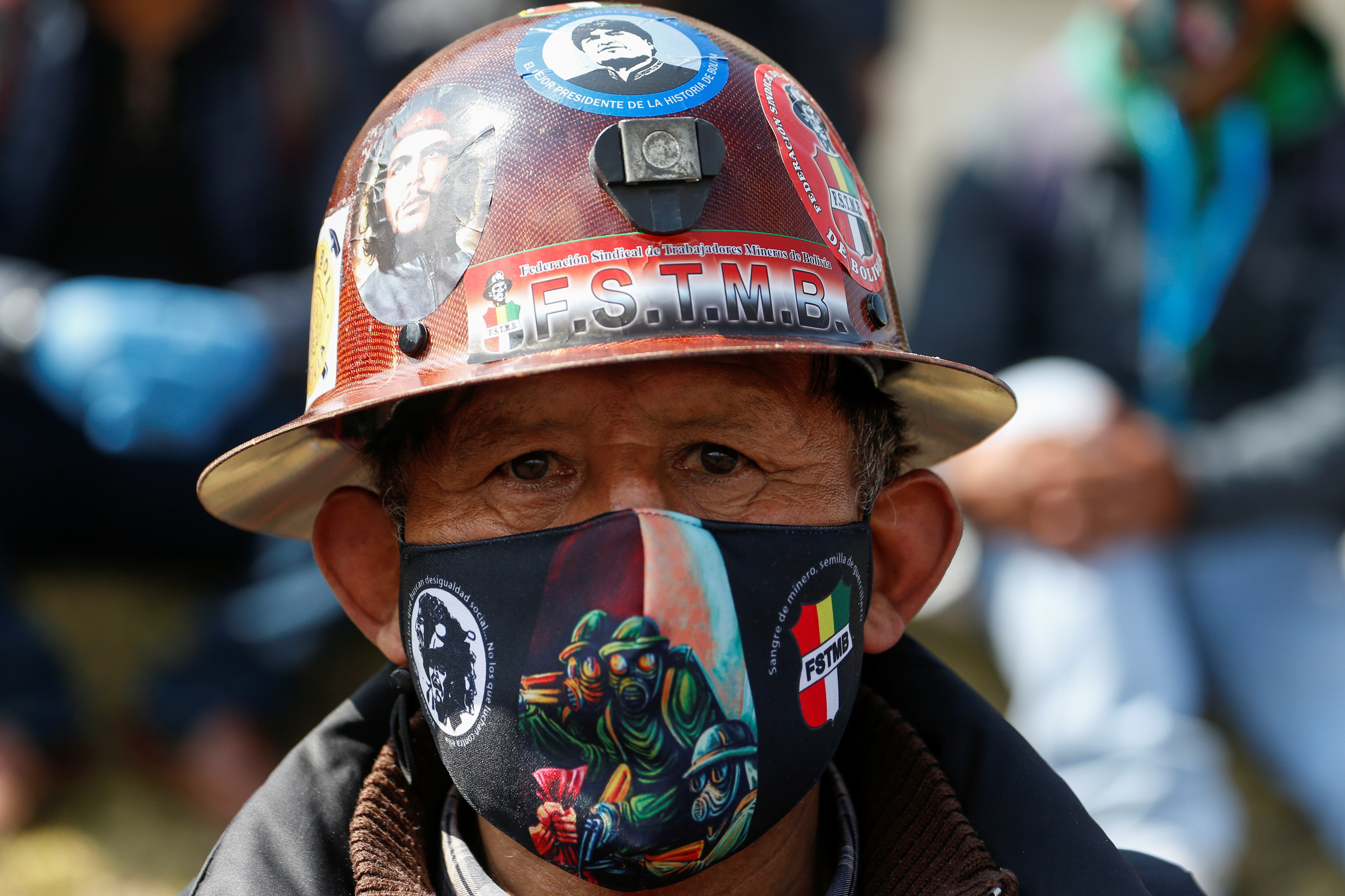 A mine worker looks on during a protest rally called by Bolivian workers unions, against interim President Jeanine Anez government demanding the economic reactivation of their sectors, amid the coronavirus disease (COVID-19) outbreak, in La Paz, Bolivia, July 14, 2020
