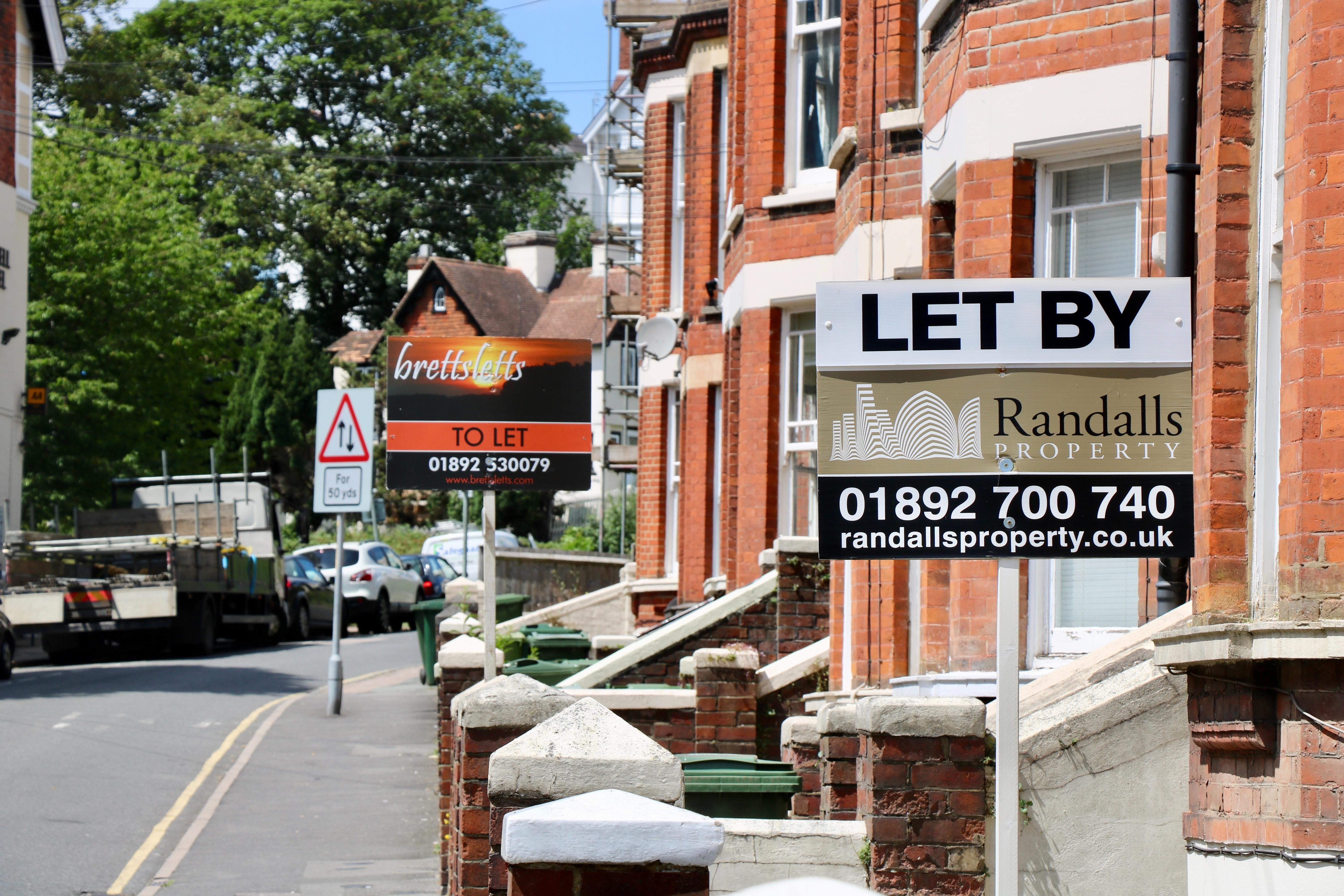 A estate agent's sign advertising that a property is for rent.