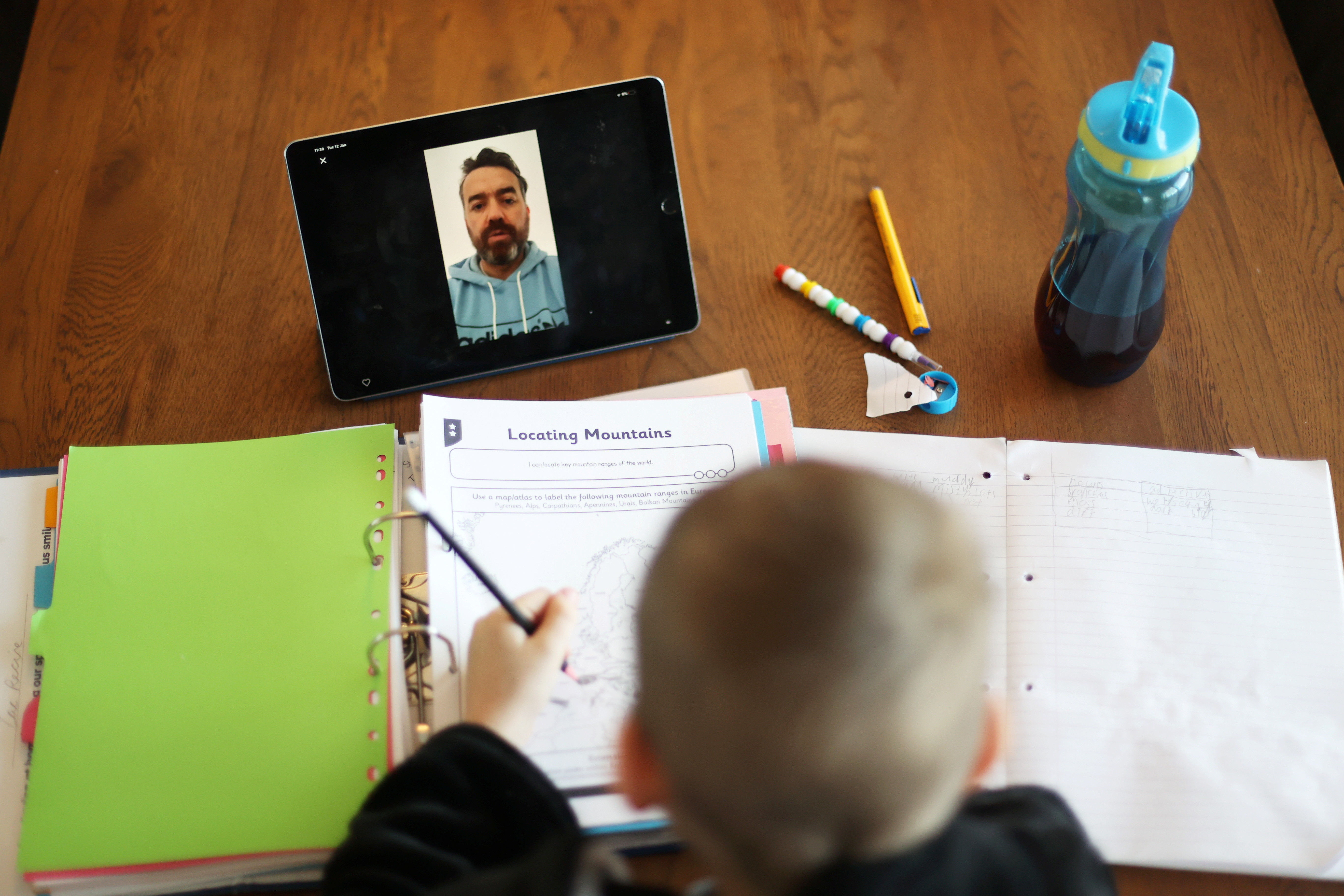 Zac receives online learning from his school amid the coronavirus disease (COVID-19) outbreak at his home in Keele, Staffordshire, Britain January 12, 2021.