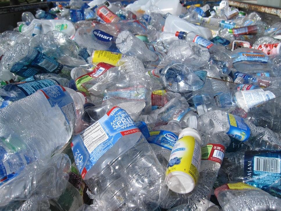 A number of used and crumpled plastic bottles.