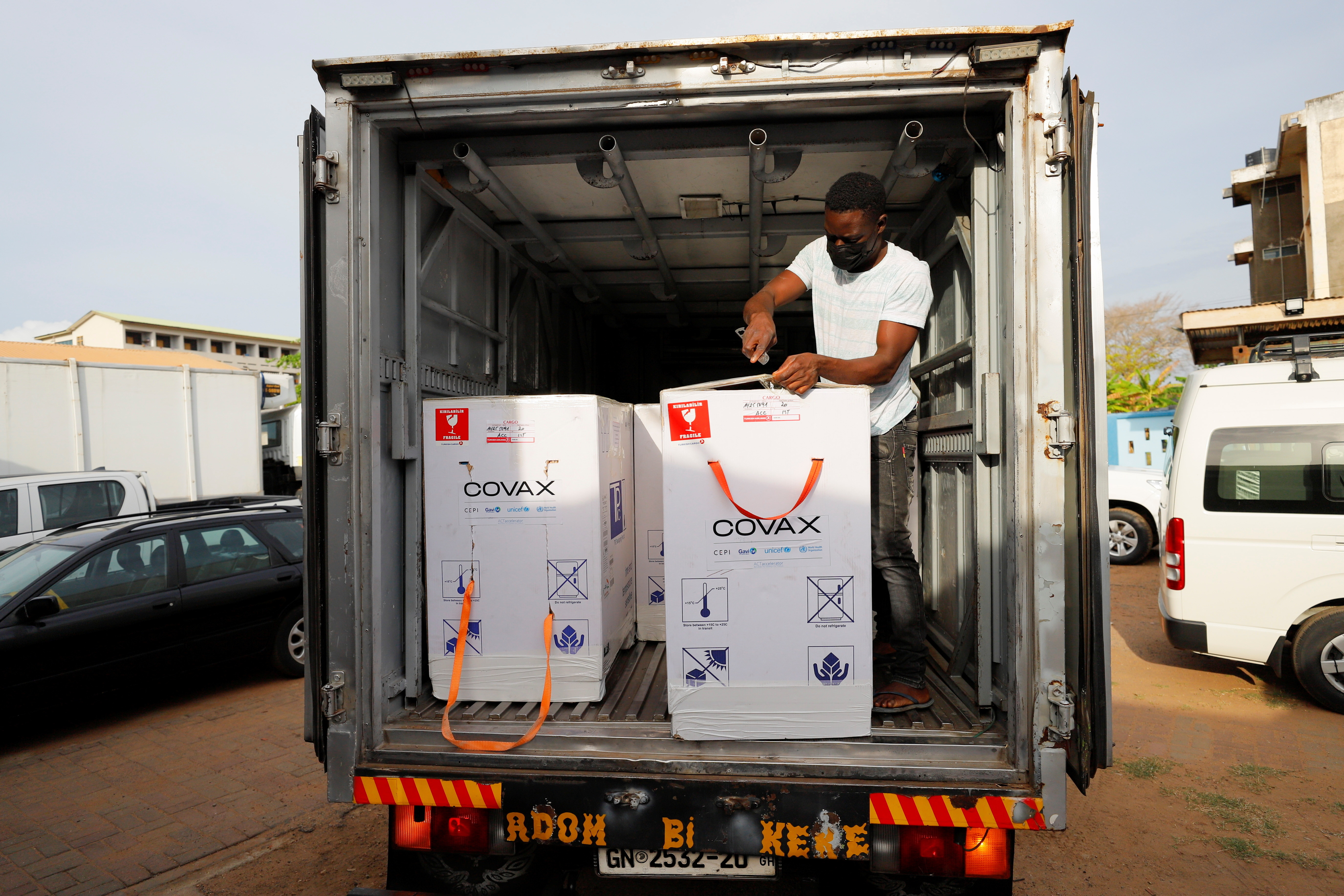 Boxes of Oxford/AstraZeneca coronavirus disease (COVID-19) vaccines, redeployed from the Democratic Republic of Congo, are seen loaded onto a refrigerated delivery truck in Accra, Ghana, May 7, 2021.