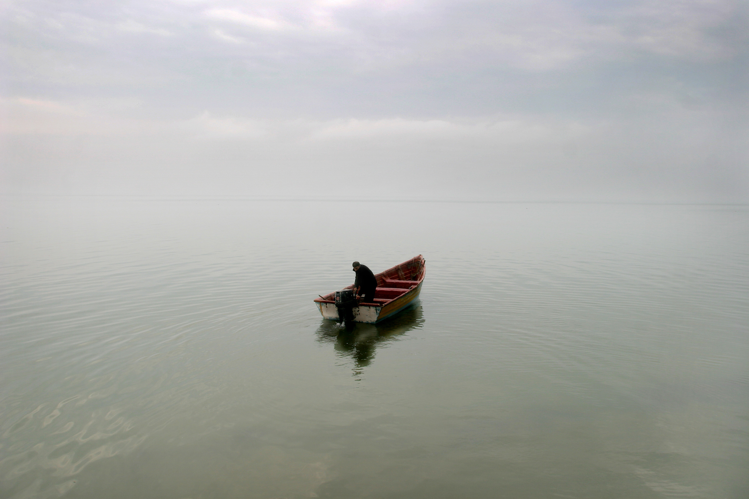 a picture of a boat out at sea