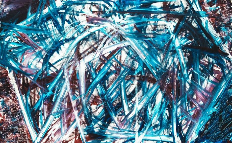 A painting using chaotic brush strokes in blue and dark red.