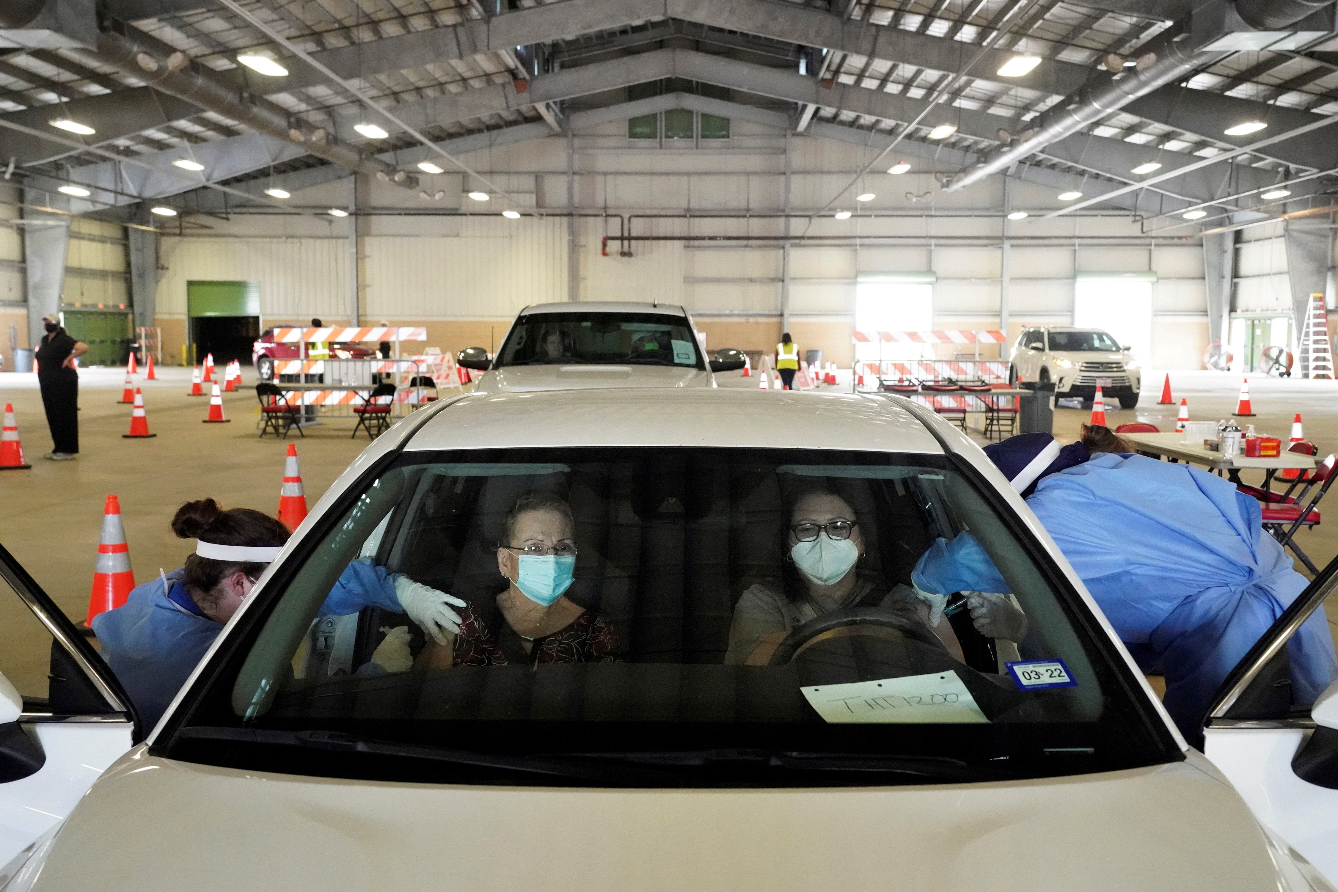 Eva Martinez and Sandra Vaden receive vaccination against coronavirus disease (COVID-19) at a drive-through site in Robstown, Texas, U.S. February 9, 2021.  REUTERS/Go Nakamura     TPX IMAGES OF THE DAY - RC28PL9JNC5D