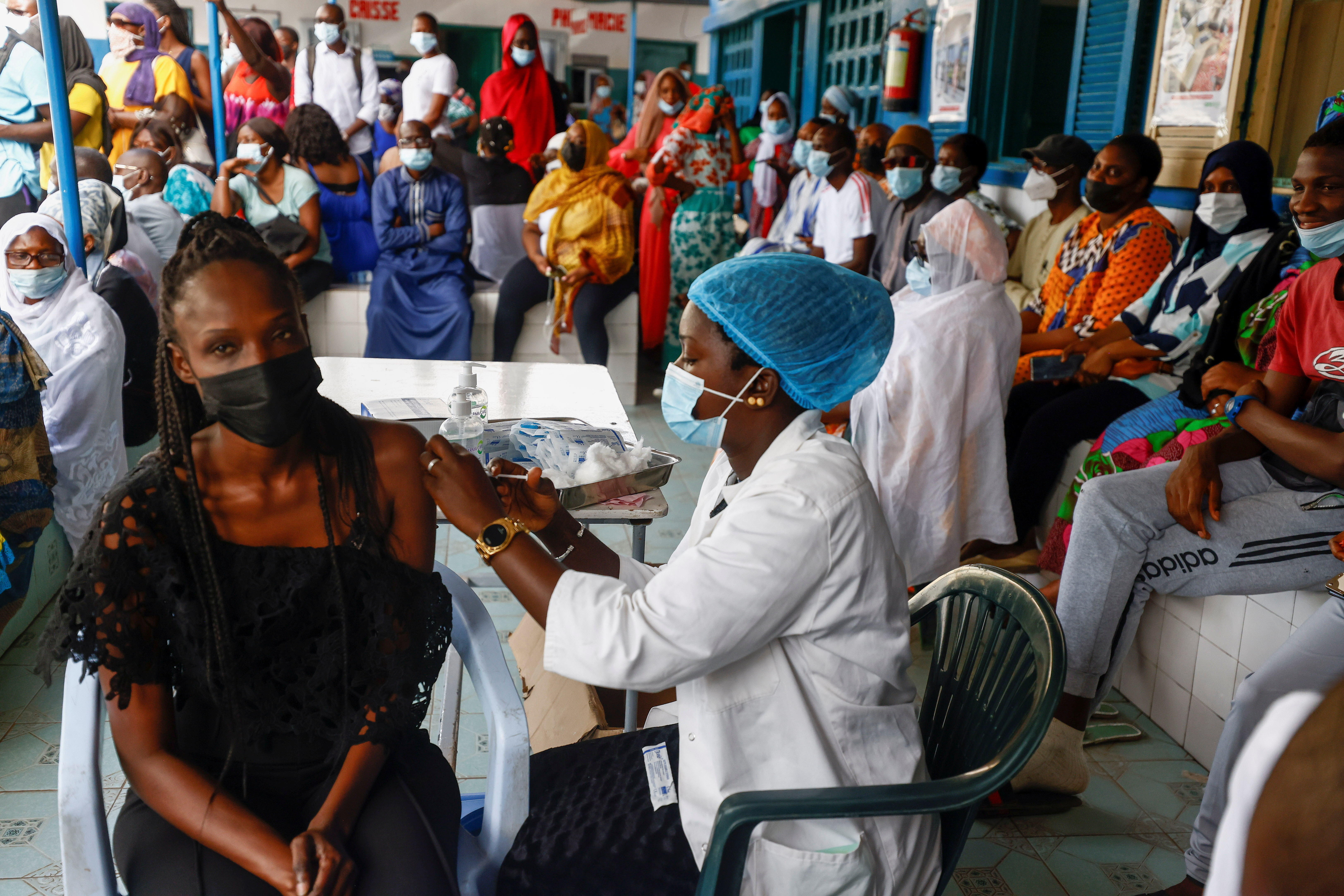 Aminata Laye Diagne, a nurse gives a dose of coronavirus disease (COVID-19) vaccine to a woman at Philippe Senghor Hospital  in Dakar, amid a surge of coronavirus disease (COVID-19) cases in Senegal July 28, 2021. Picture taken July 28, 2021.