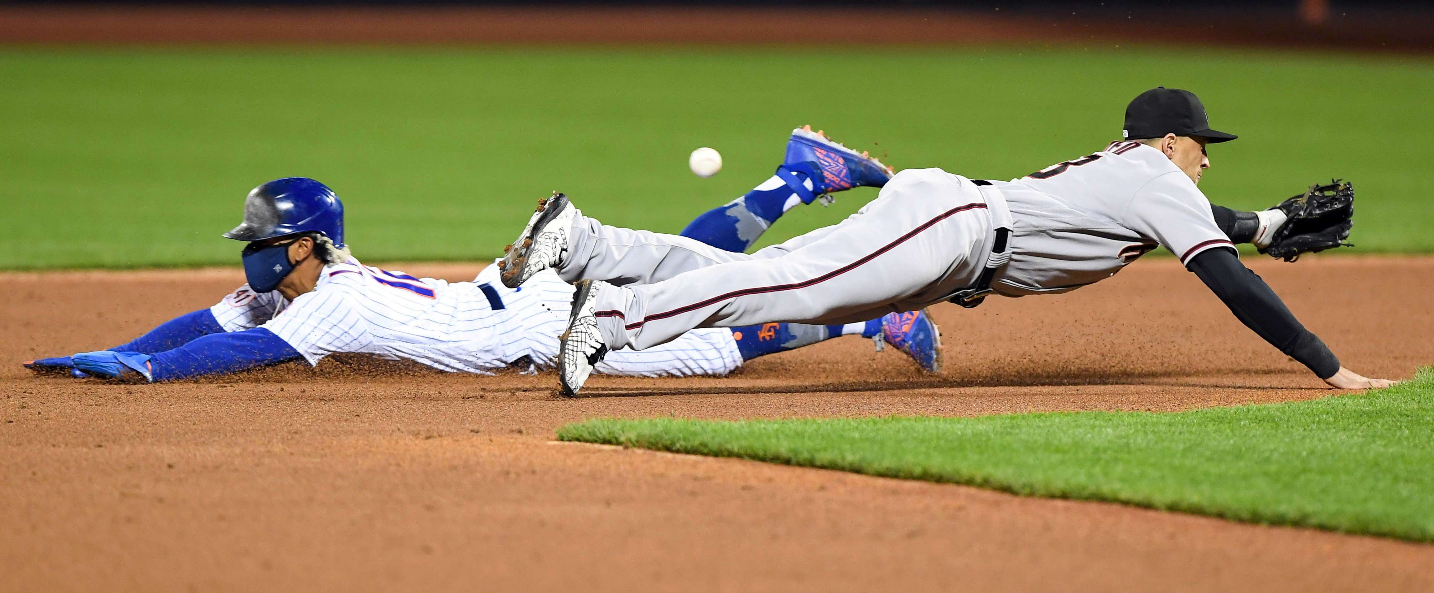 May 8, 2021; New York City, New York, USA; New York Mets shortstop Francisco Lindor (12) steals second base as Arizona Diamondbacks shortstop Nick Ahmed (13) dives for the ball in the third inning at Citi Field. Mandatory Credit: Dennis Schneidler-USA TODAY Sports     TPX IMAGES OF THE DAY - 16051466