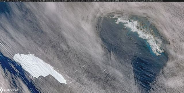 A satellite image of the A-68A iceberg (L) as it approaches South Georgia island (R) in the South Atlantic, December 4, 2020. Picture taken December 4, 2020.
