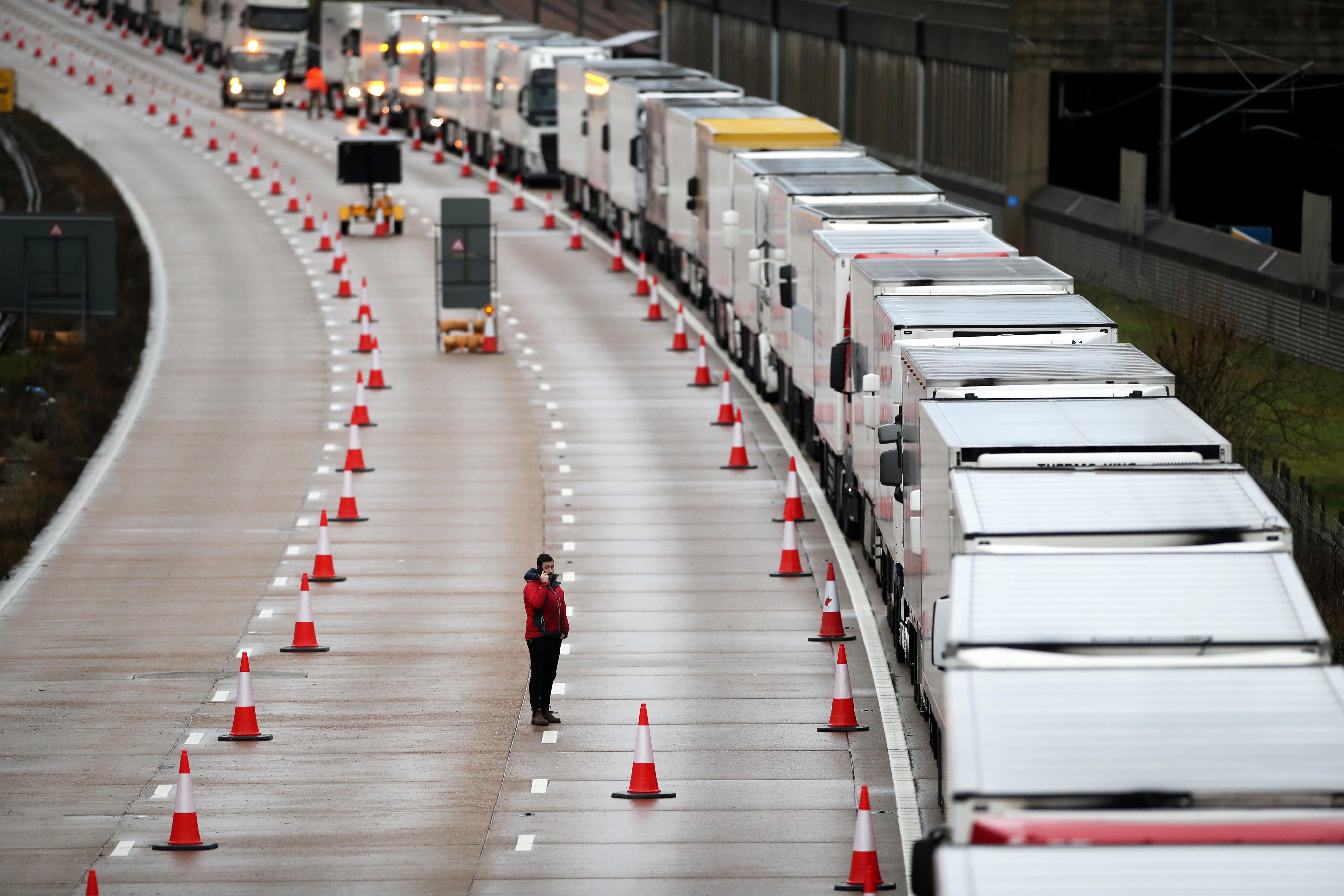 Lorries queue on the M20 motorway as part of Operation Stack following the coronavirus disease