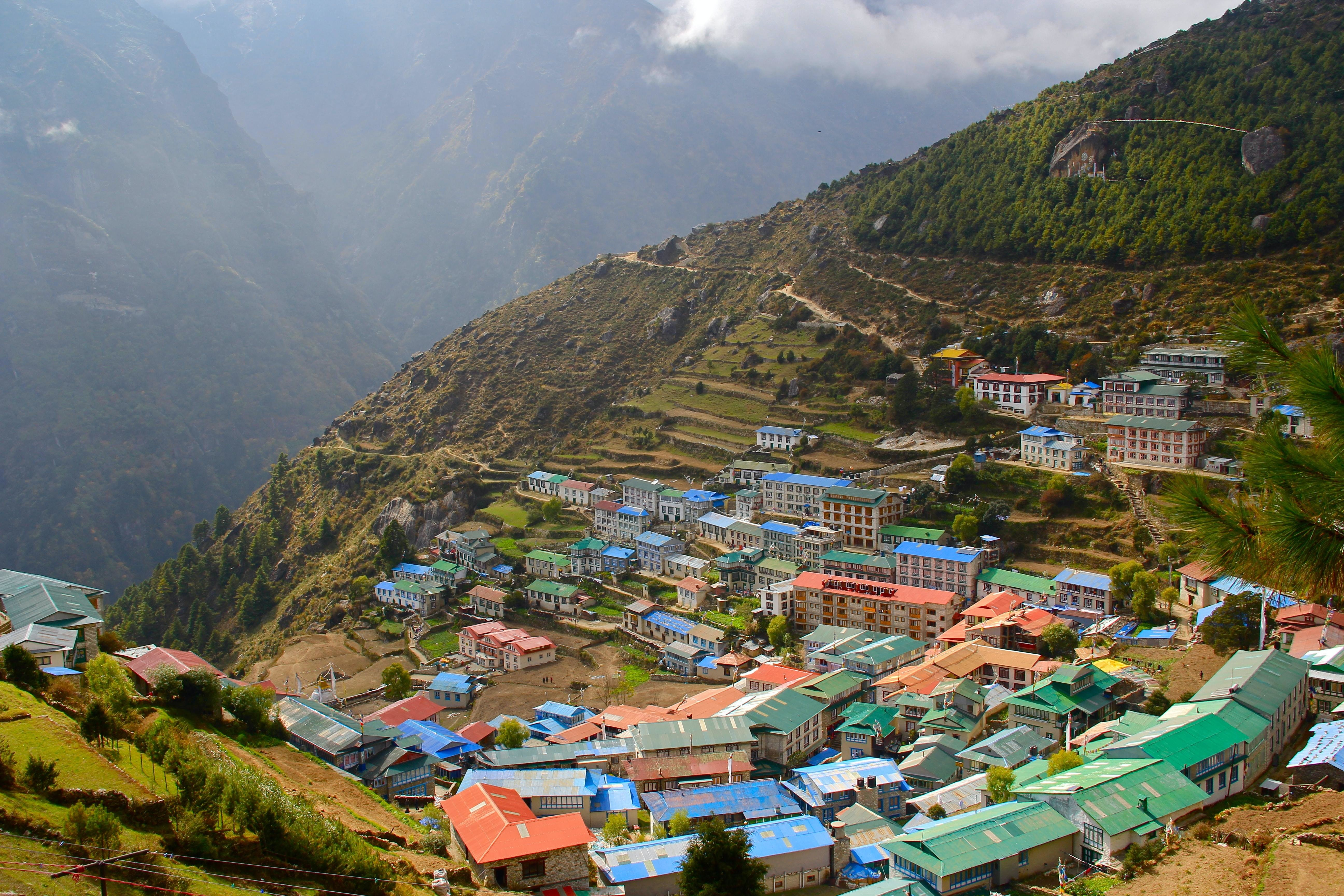 Namche Bazar, Namche, Nepal; rural, mountainside village; blue, green and red rooftops.