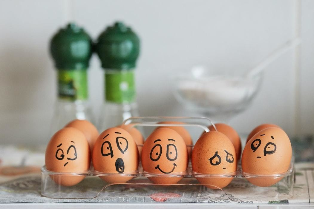 image of some eggs with different faces
