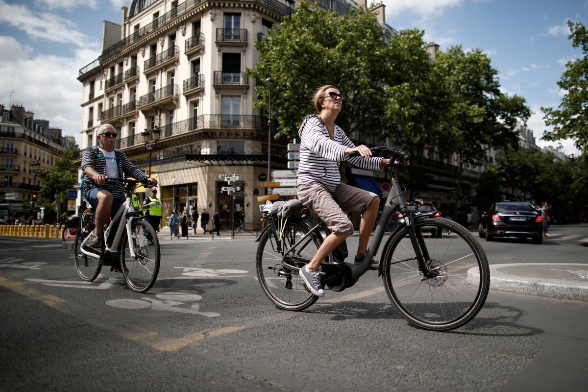 image of a woman riding an electric bike in Paris