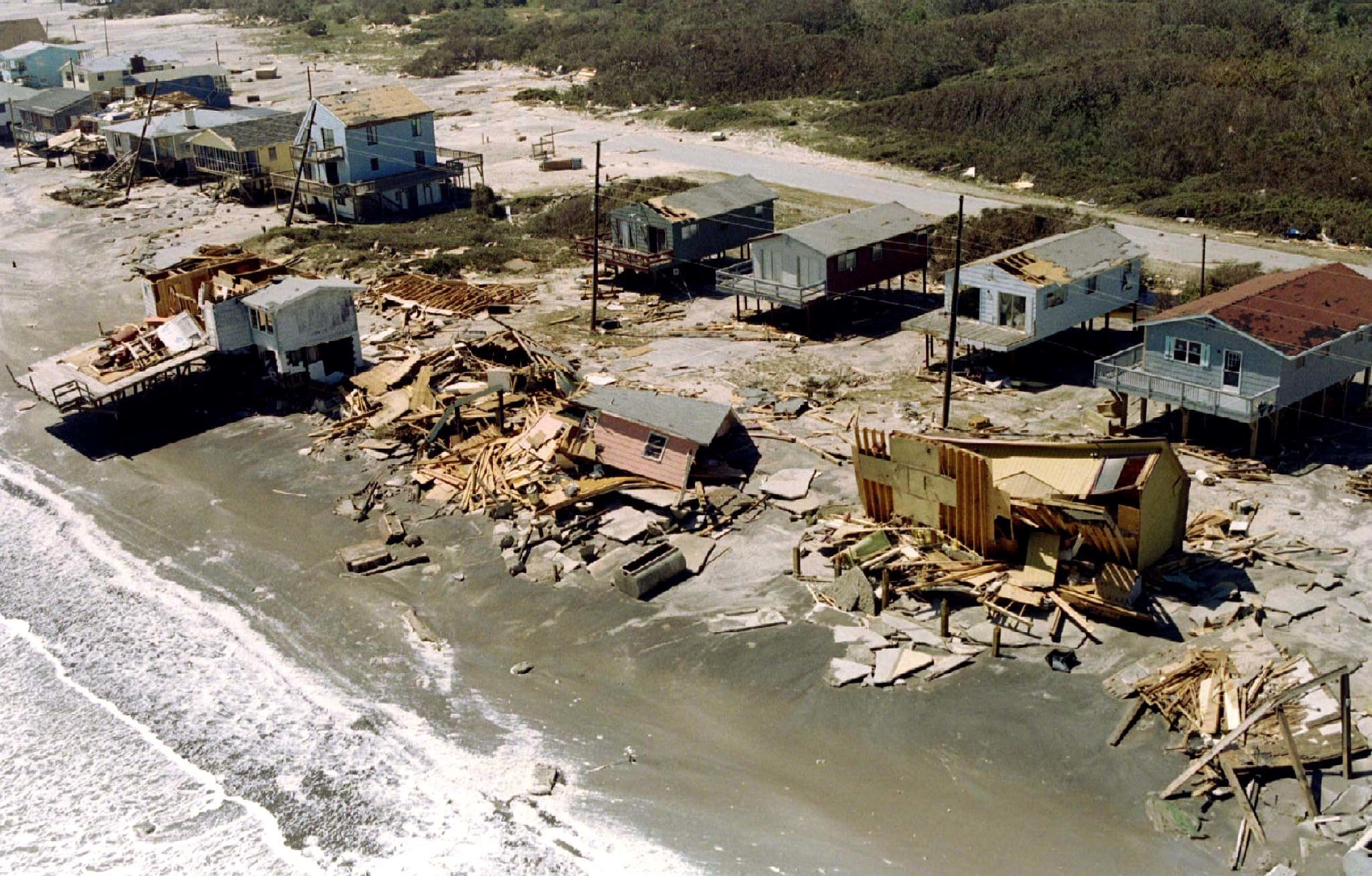 image of the remains of beach front houses lie on the sand in Surf City, North Carolina destroyed by the gale force winds of Hurricane Fran. The brunt of the winds and rain were felt the most by the outer banks islands in North Carolina.