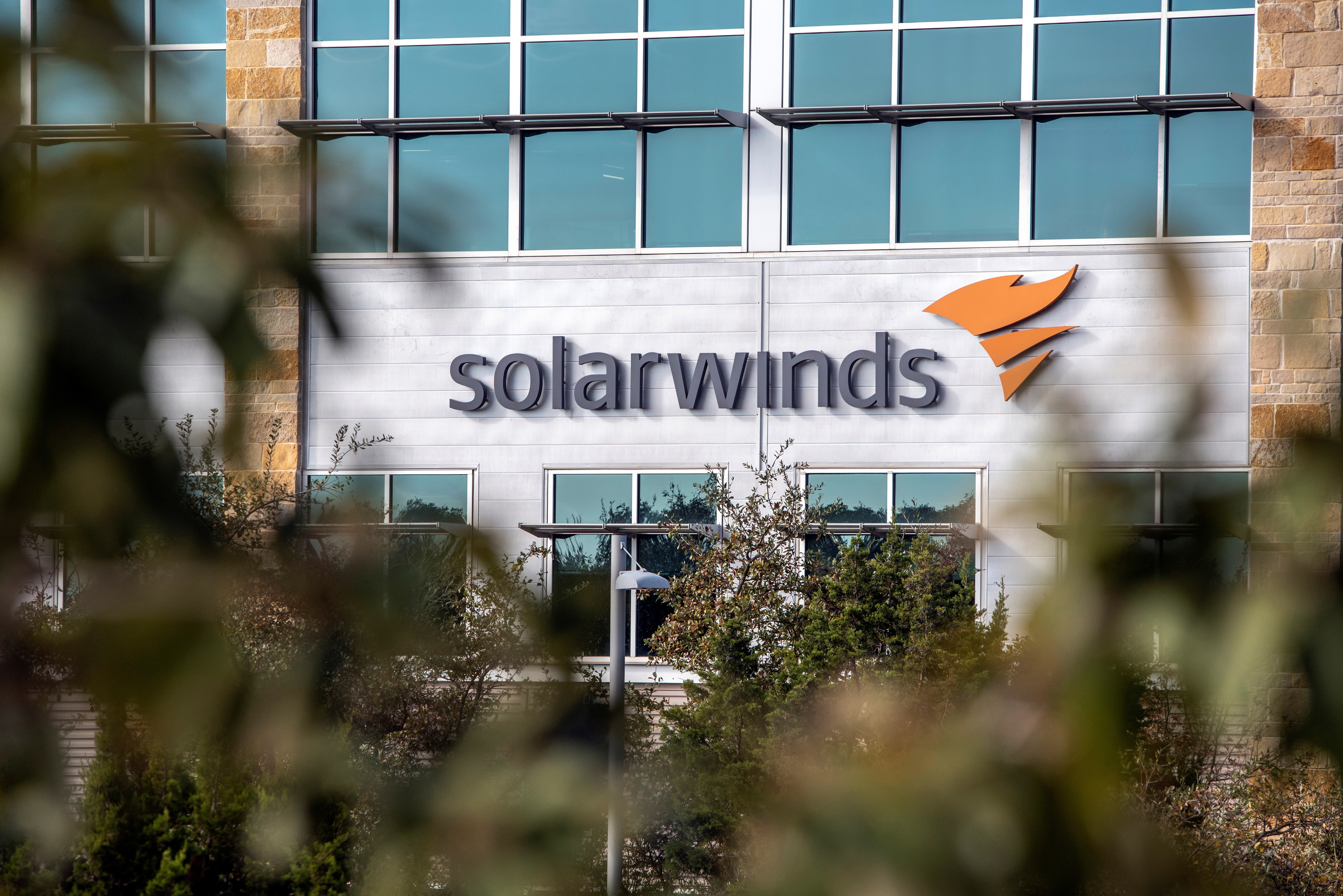 The SolarWinds logo is seen outside its headquarters in Austin, Texas, U.S., December 18, 2020. REUTERS/Sergio Flores - RC2UPK949M6J
