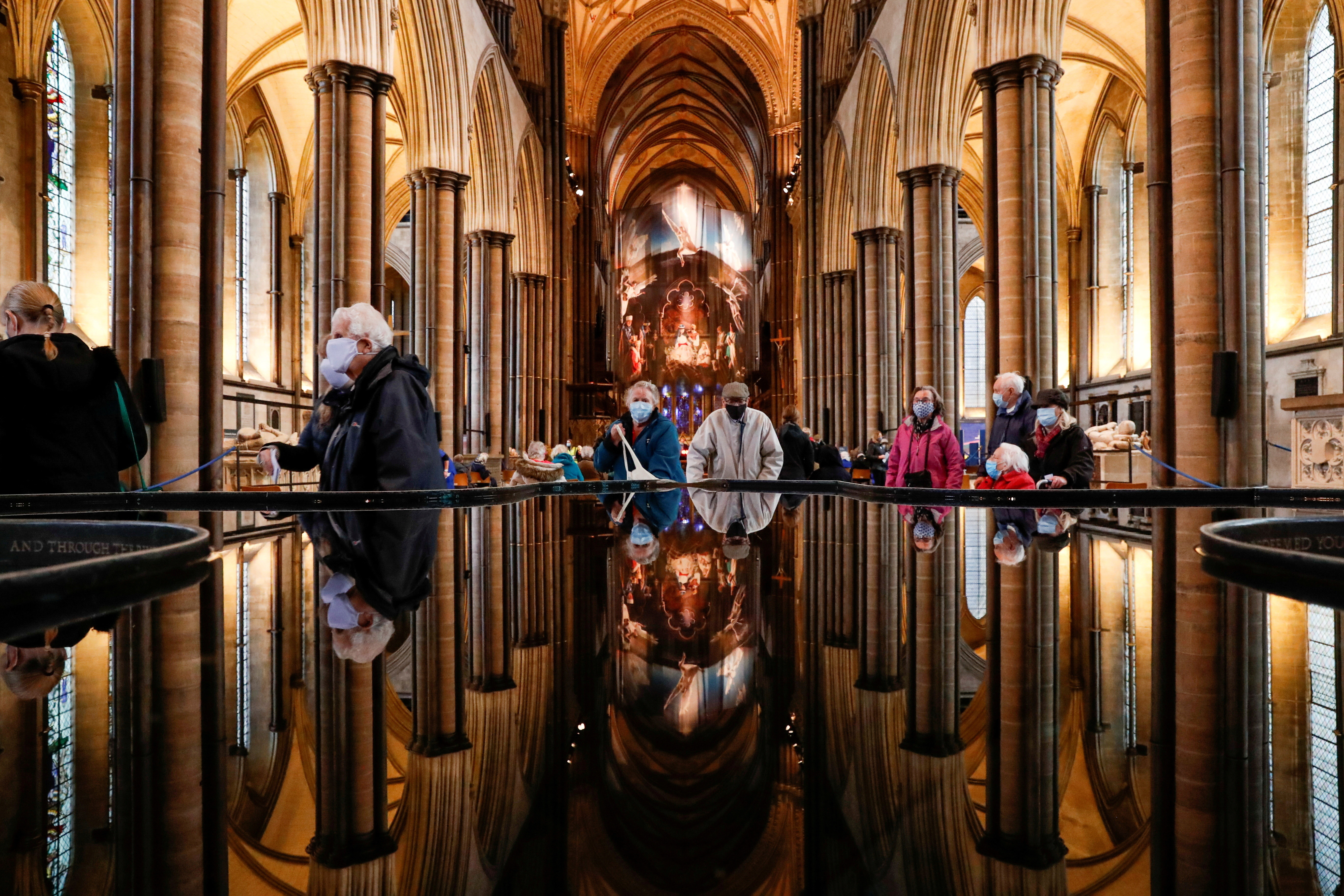 People wait to receive the coronavirus disease (COVID-19) vaccine at a vaccination centre inside the Salisbury Cathedral, in Salisbury, Britain January 20, 2021. REUTERS/Paul Childs     TPX IMAGES OF THE DAY - RC2MBL9VVKVM