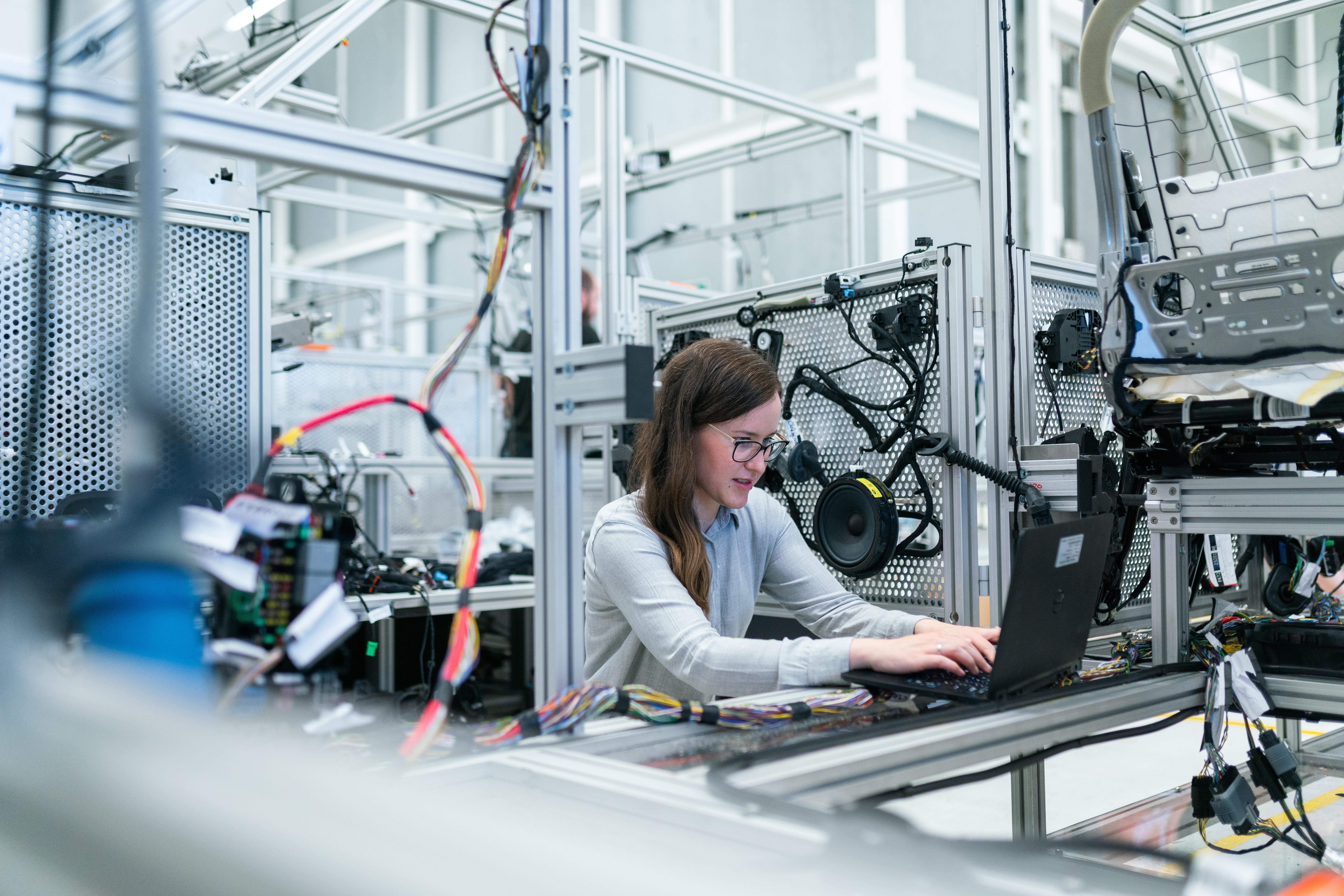 Female electronics engineer runs vehicle tests.