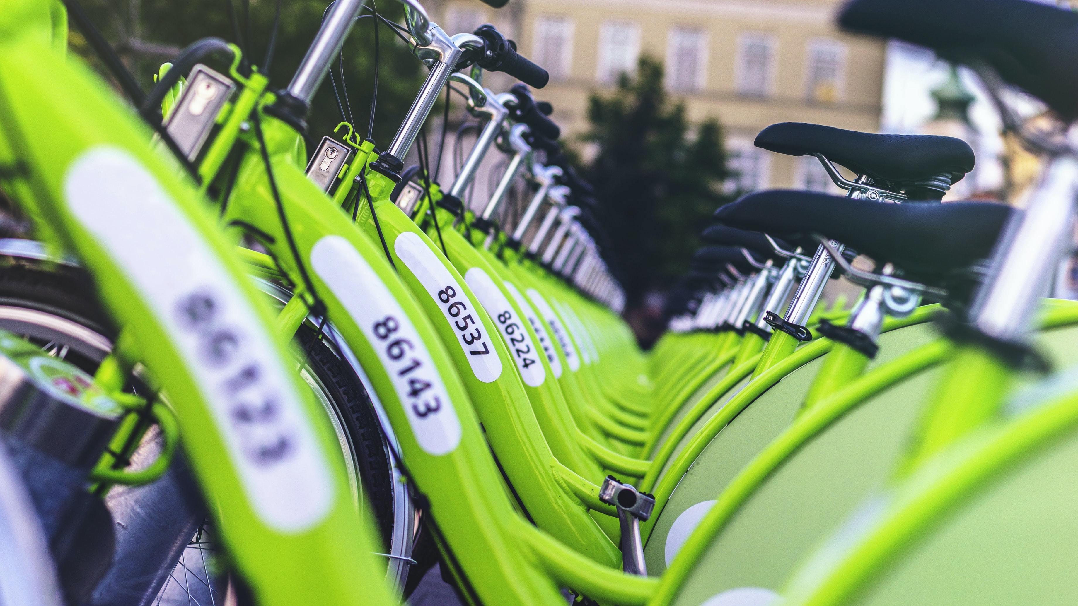 Row of green bikes.