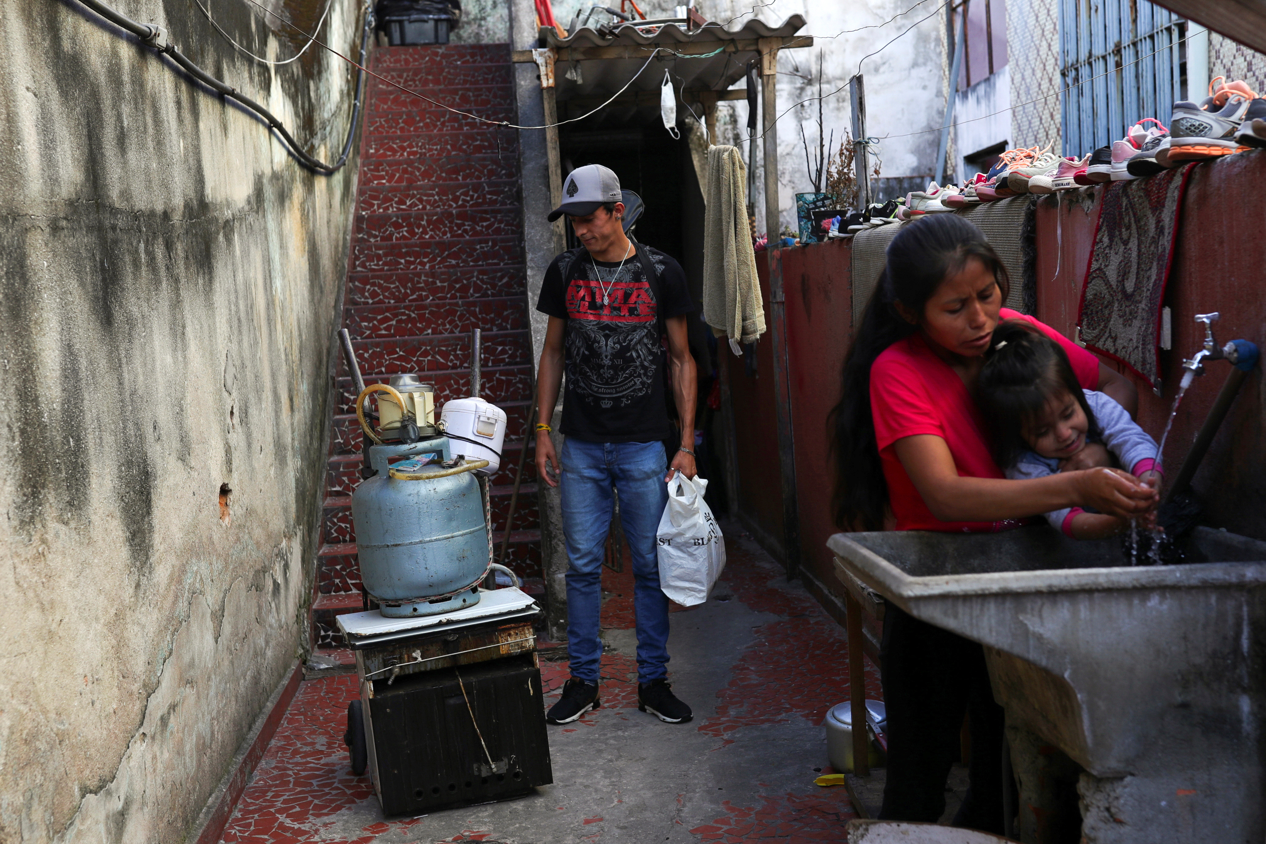 Douglas Felipe Alves Nascimento, 21, who lost his job at a textile firm and tries to make a living selling candy on the streets, looks at a cart with personal items he sold to pay the rent, during the coronavirus disease (COVID-19) pandemic, in Sao Paulo, Brazil August 4, 2020. Picture taken August 4, 2020. REUTERS/Amanda Perobelli - RC2PDJ9KH1DM