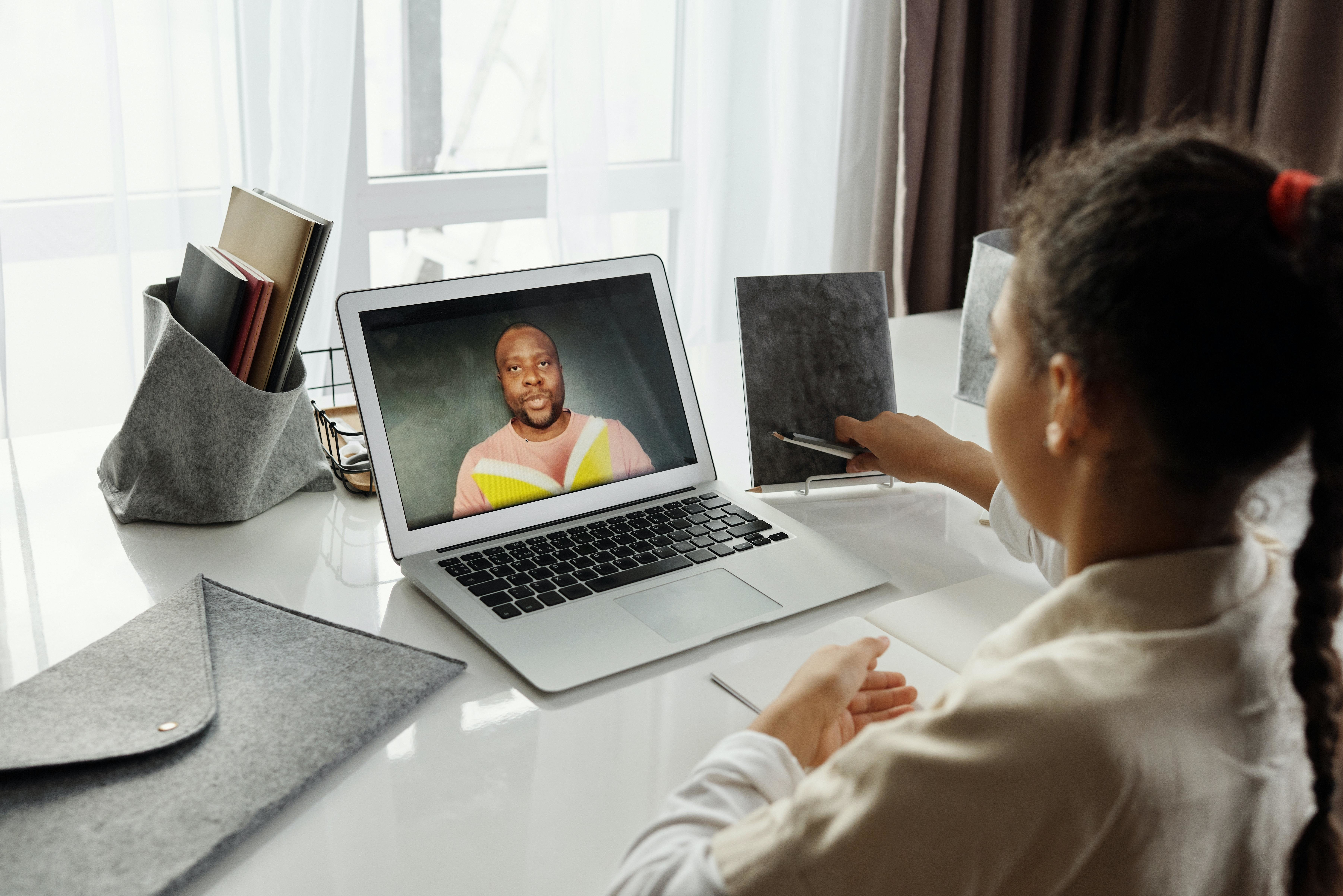 Girl taking an online school lesson.