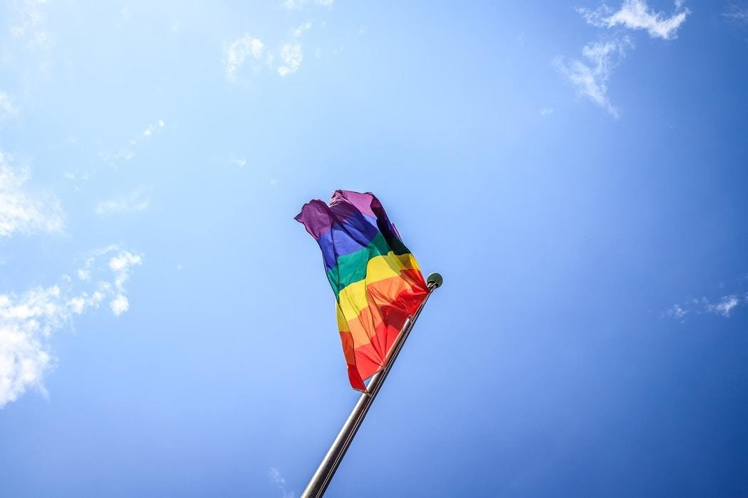 A flag with the LGBTQ colours.