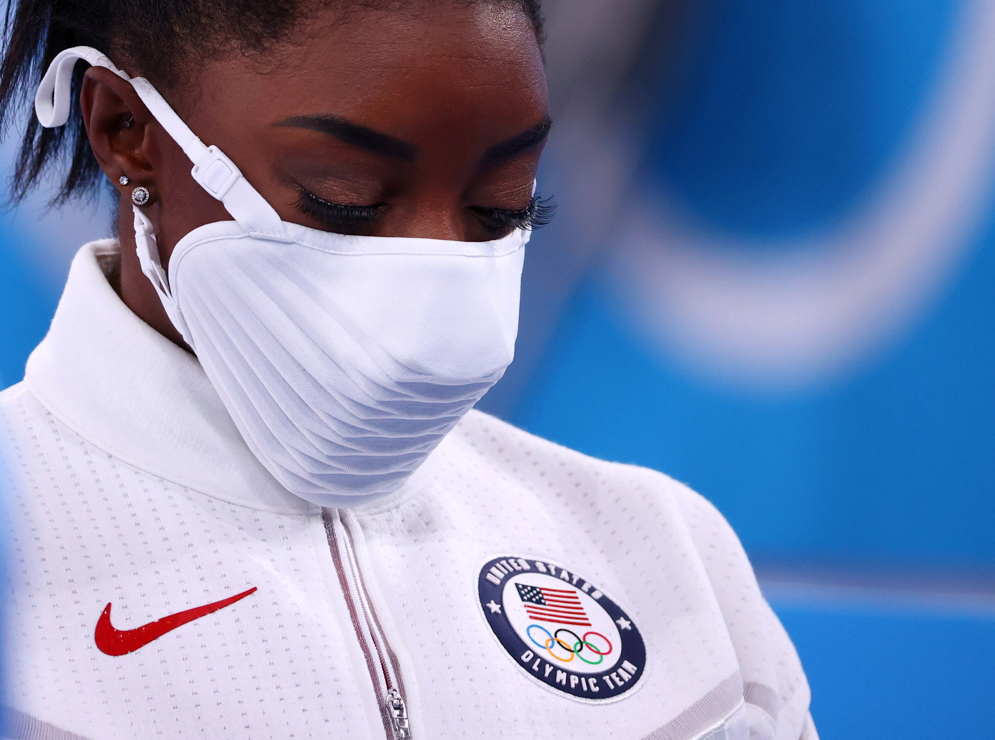 Tokyo 2020 Olympics - Gymnastics - Artistic - Women's Team - Final - Ariake Gymnastics Centre, Tokyo, Japan - July 27, 2021.  Silver medallist Simone Biles of the United States wearing a protective face mask looks down. REUTERS/Lindsey Wasson     TPX IMAGES OF THE DAY - SP1EH7R10FGNJ