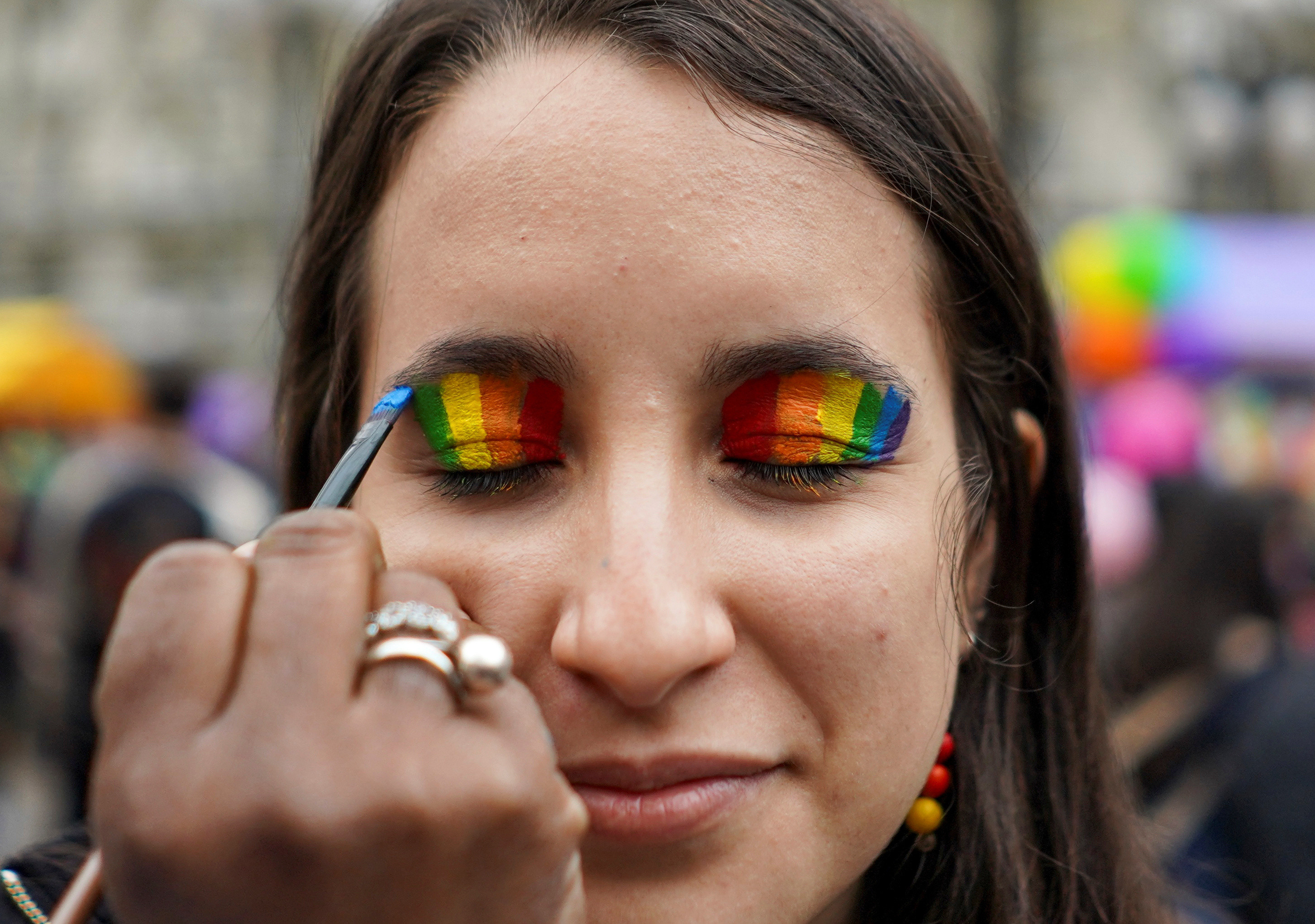A member of the LGBT community gets ready to participate in the annual Diversity March, which this year has been downscaled amid the coronavirus disease (COVID-19) pandemic, in downtown Montevideo, Uruguay September 25, 2020. Picture taken September 25, 2020. REUTERS/Mariana Greif - RC2I6J94RKJ6