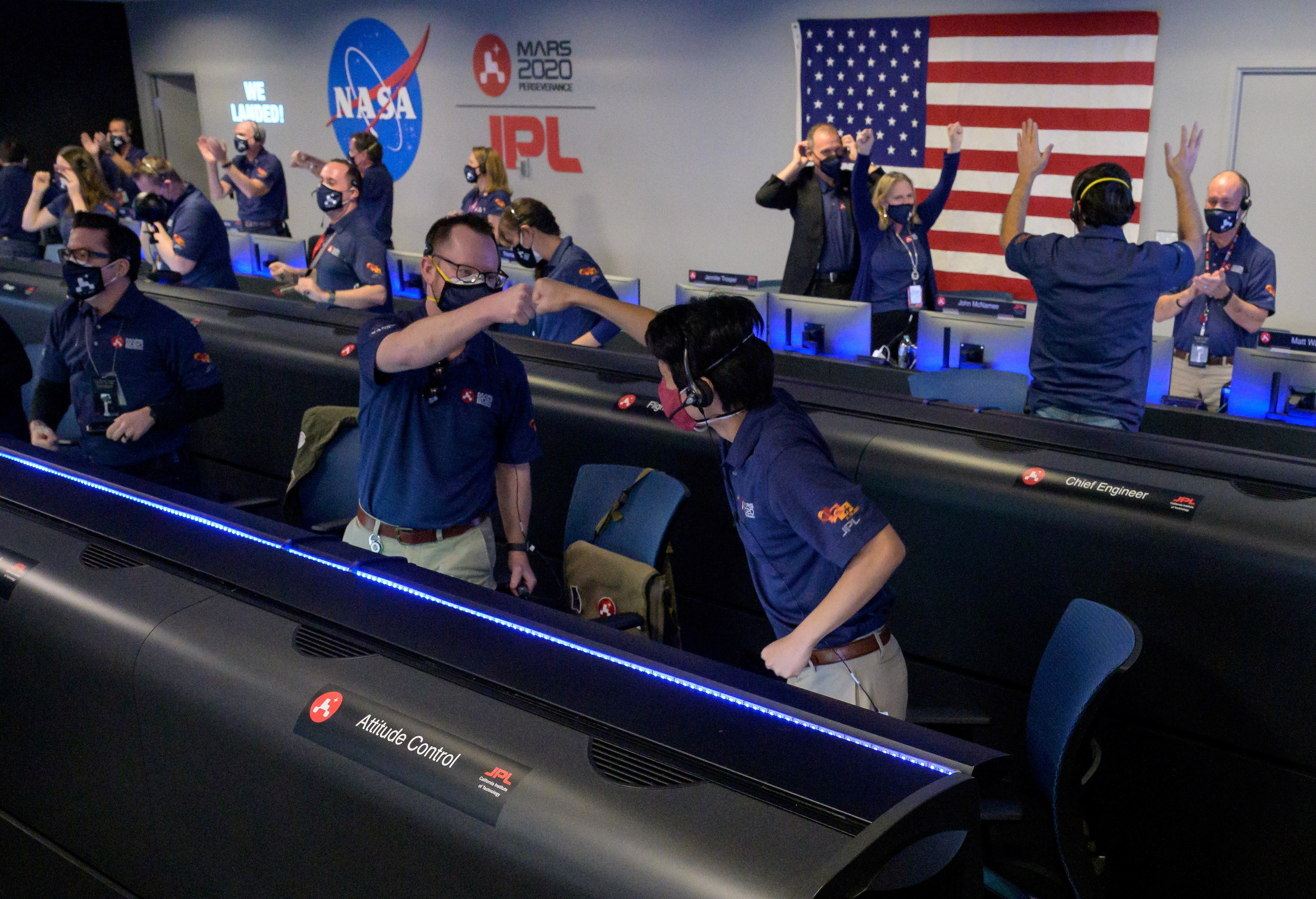 Members of NASA's Perseverance rover team react in mission control after receiving confirmation the spacecraft successfully touched down on Mars, at NASA's Jet Propulsion Laboratory in Pasadena, California, U.S. February 18, 2021. Picture taken February 18, 2021.  NASA/Bill Ingalls/Handout via REUTERS. MANDATORY CREDIT. THIS IMAGE HAS BEEN SUPPLIED BY A THIRD PARTY. - RC2WVL9JKDBA