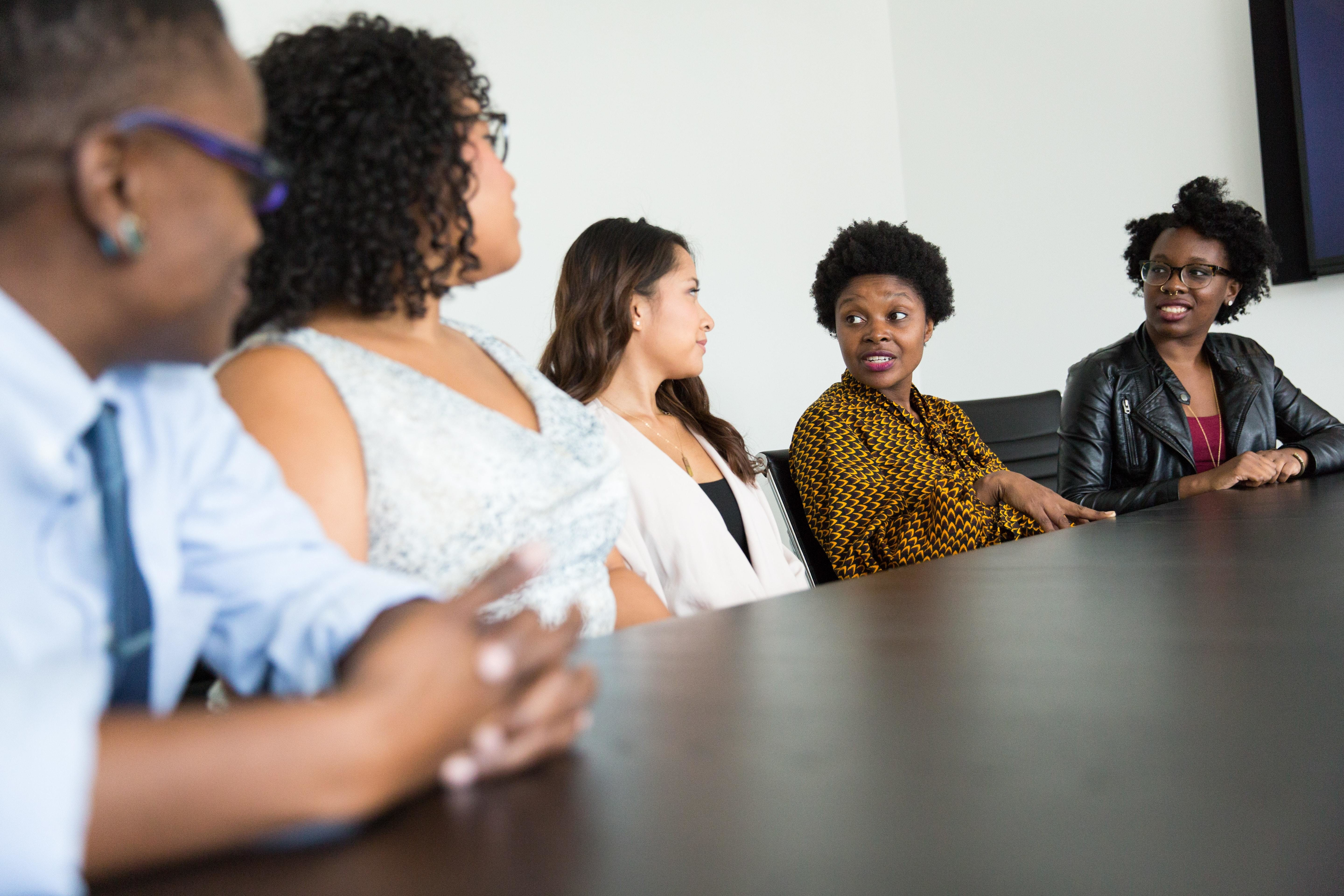shown here is a variety of different people at a board meeting. Singapore is setting a strong example for how to incorporate diversity into workplaces like this one