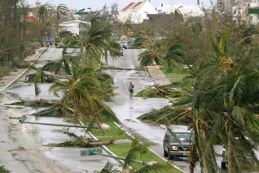 A general view of a principal hotel avenue after Hurricane Wilma hit the resort town of Cancun in Mexico's state of Quintana Roo, October 23, 2005. Mexico's famed Carribean resorts were knee-deep in water on Sunday after Hurricane Wilma roared past, uprooting trees, smashing homes and killing at least six people, as the storm set a new course [for Florida]. - PBEAHUNVWBG