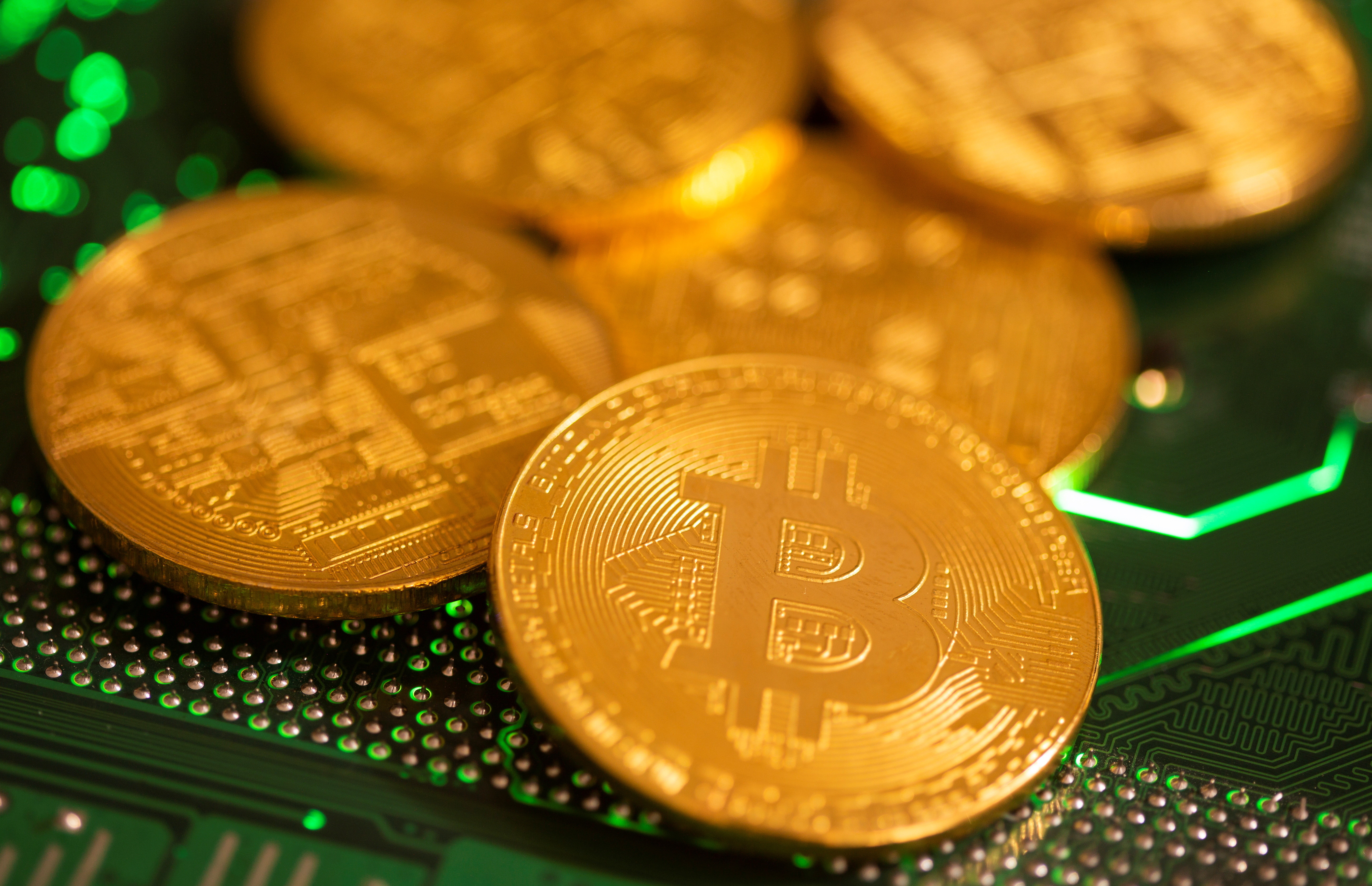 Representations of virtual currency Bitcoin are placed on a computer motherboard in this illustration taken January 21, 2021. REUTERS/Dado Ruvic/Illustration - RC2MCL97GFOK