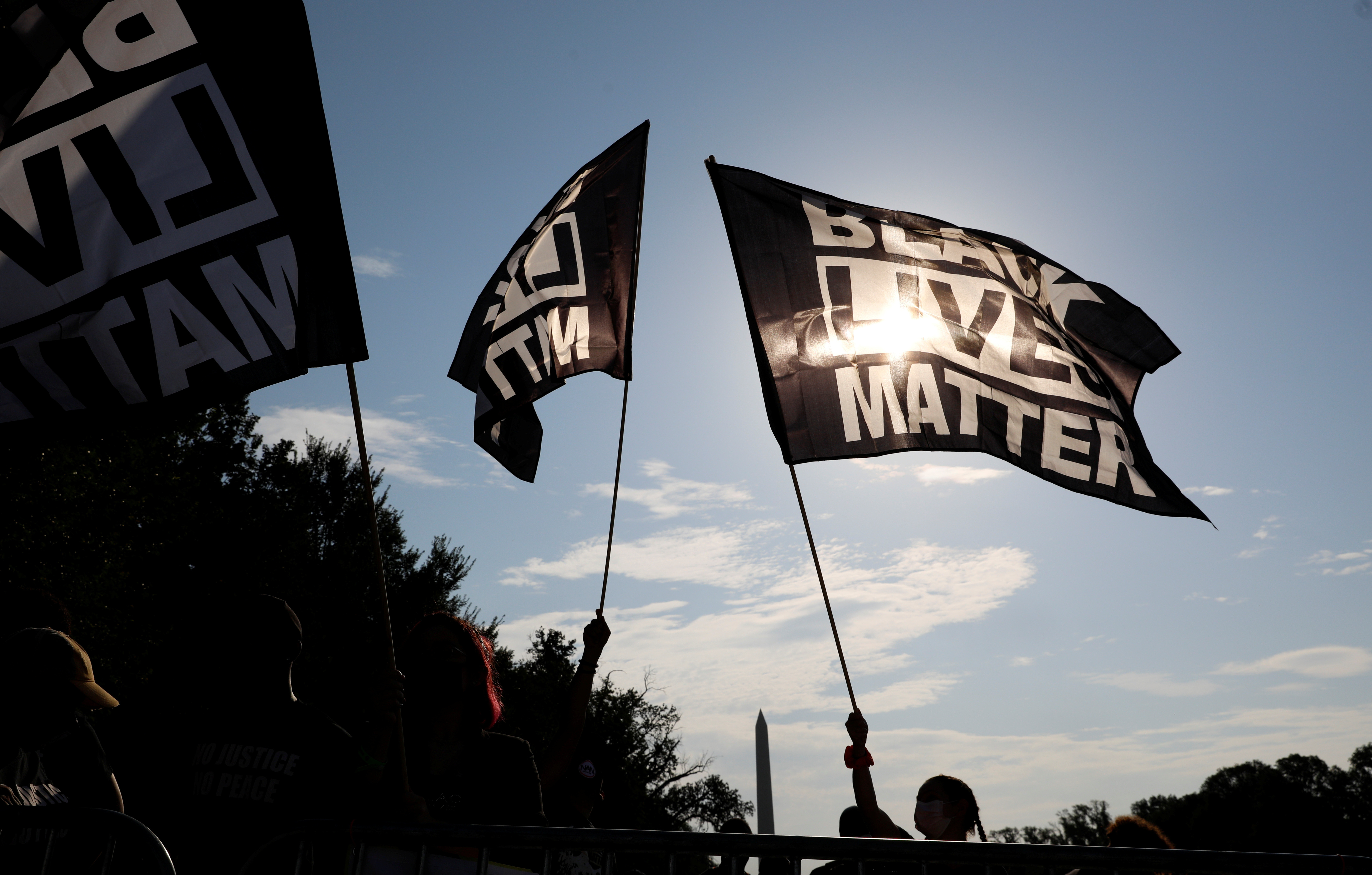 "Demonstrators with ""Black Lives Matter"" banners begin to gather at the Lincoln Memorial for the ""Get Your Knee Off Our Necks"" rally and March on Washington 2020 in support of racial justice in Washington, U.S., August 28, 2020. REUTERS/Tom Brenner - RC21NI9DH2L2"