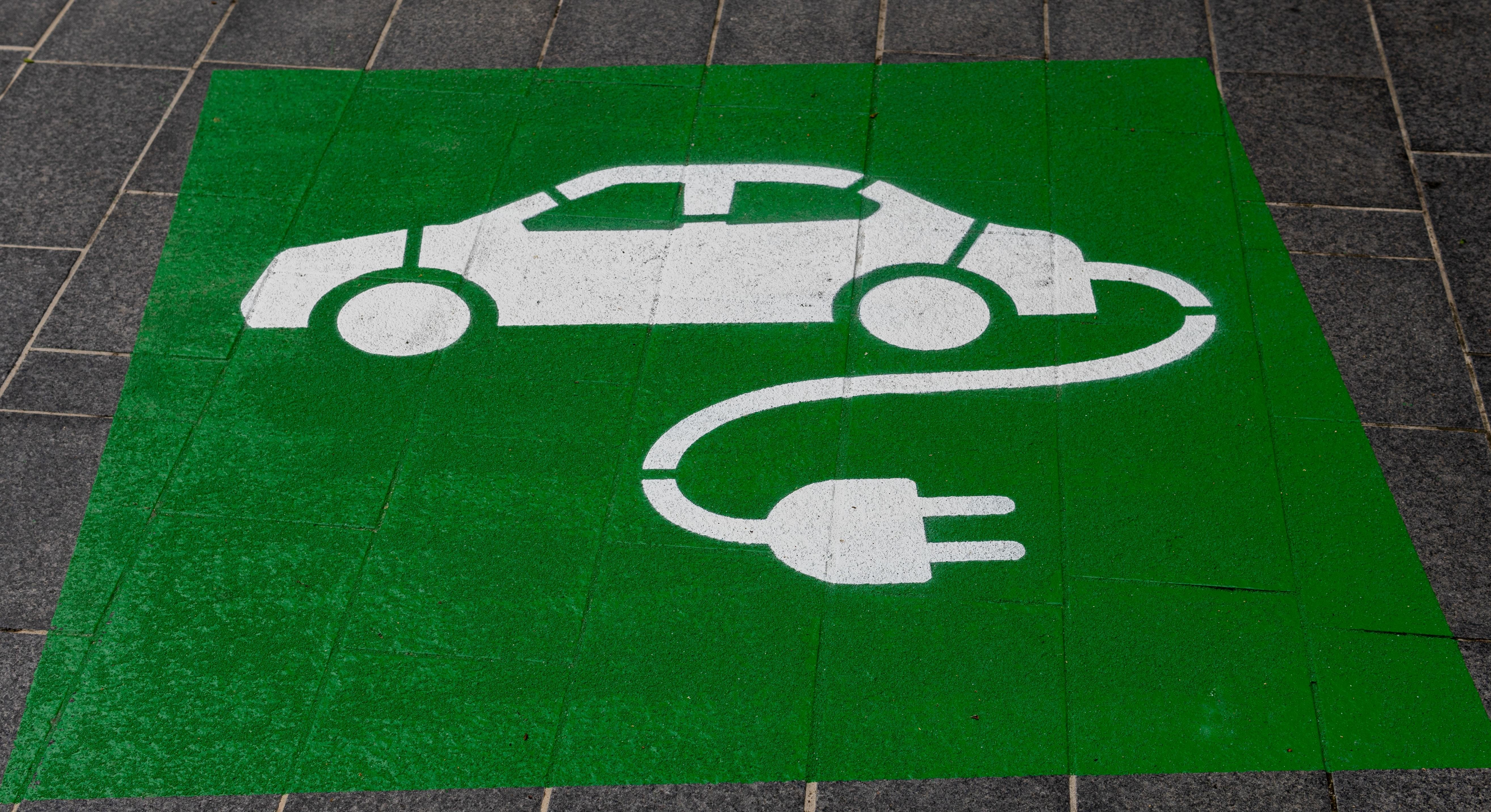 A symbol showing where electric vehicle owners can park to recharge their batteries. Photo by Michael Marais/Unsplash