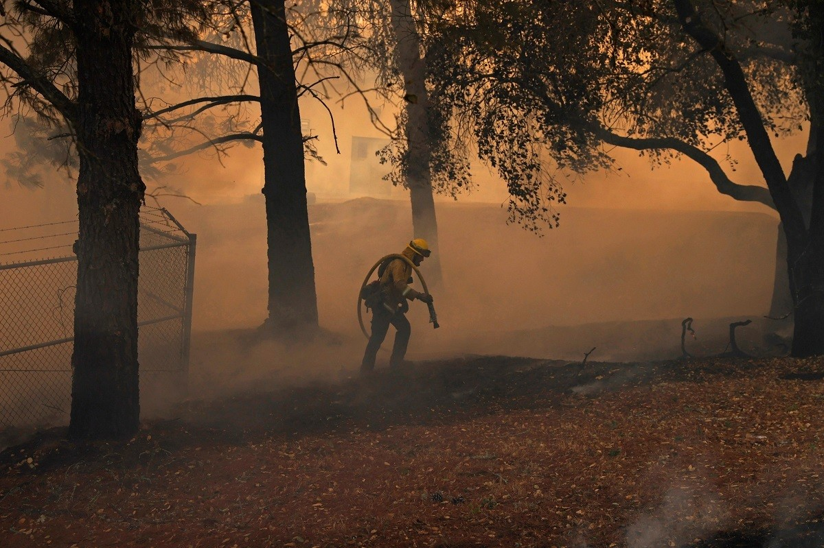 A Cal Fire firefighter works to save the Louis Stralla Water Treatment Plant during the Glass Fire in St. Helena, California, U.S. September 27, 2020. REUTERS/Stephen Lam - RC2D7J9X5T8K