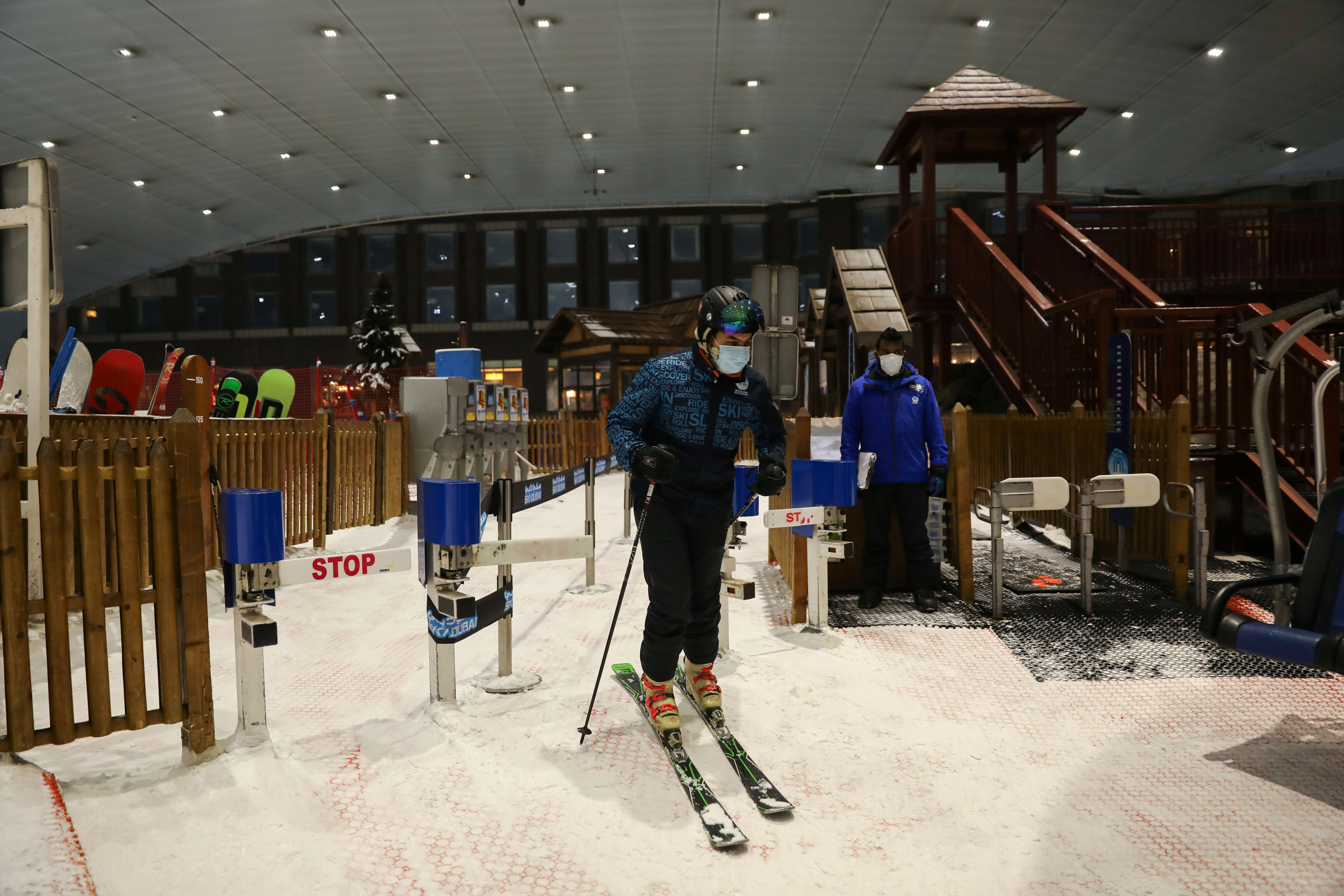 A man wearing a protective face mask gets ready to ski at Ski Dubai, following the outbreak COVID-19 in Dubai, United Arab Emirates, May 28, 2020.