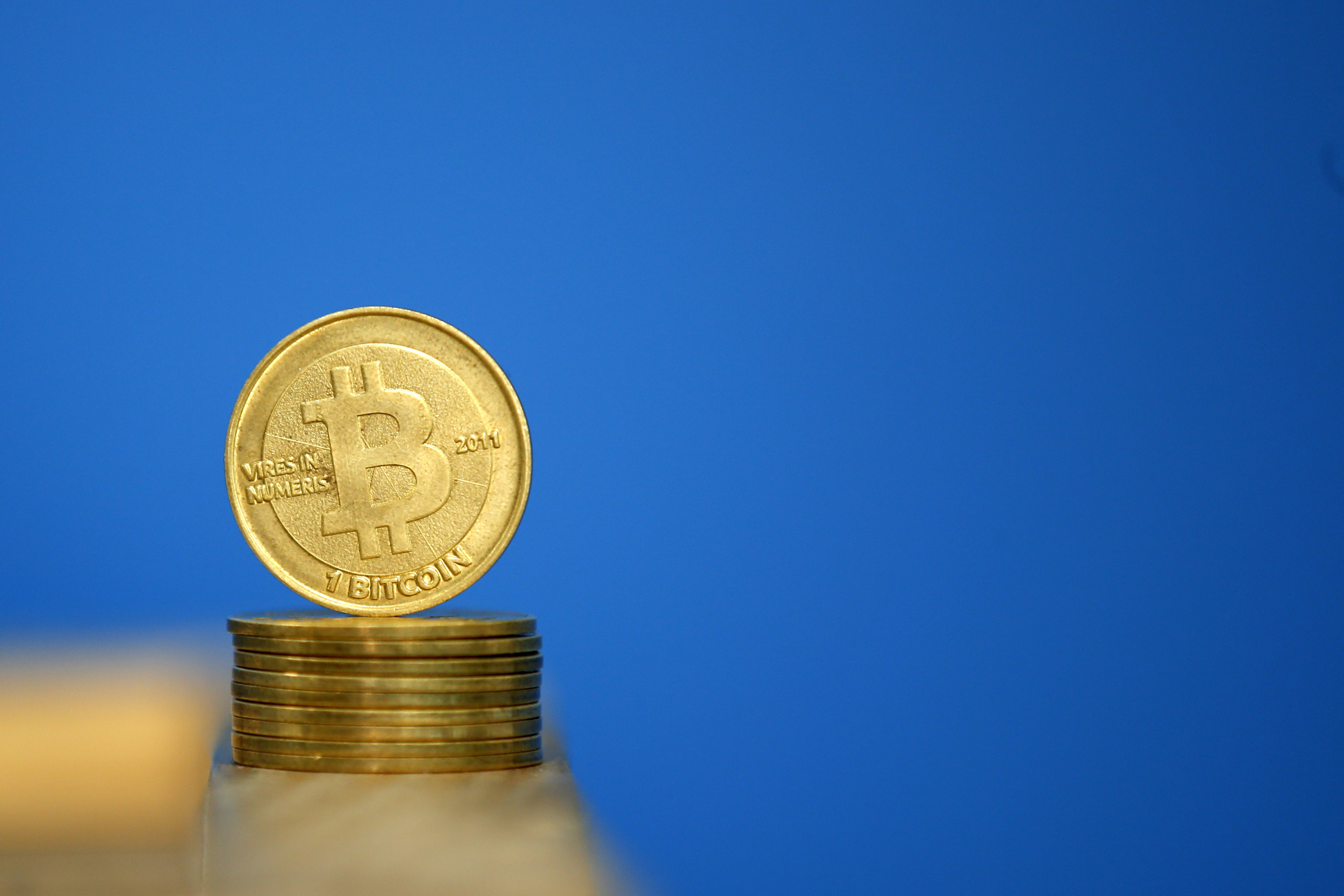 Bitcoin (virtual currency) coins are seen in an illustration picture taken at La Maison du Bitcoin in Paris July 11, 2014. French police dismantled an illegal Bitcoin exchange and seized 388 virtual currency units worth some 200,000 euros ($272,800) in the first such operation in Europe a public prosecutor said on Monday.   REUTERS/Benoit Tessier (FRANCE - Tags: BUSINESS) - PM1EA7B1GUS01