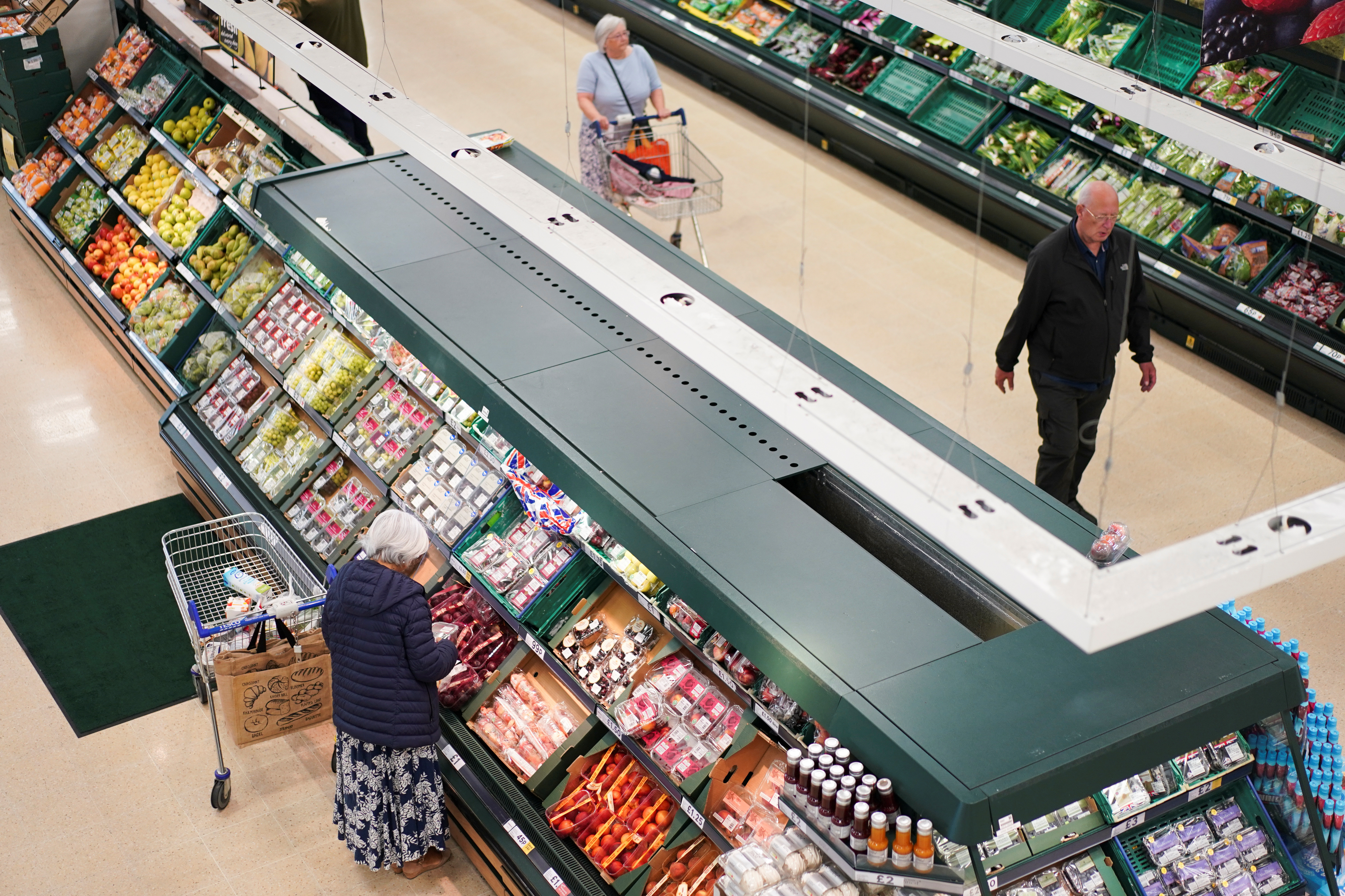 Customers shop for fruit and vegetables inside a supermarket in London, Britain August 7, 2019