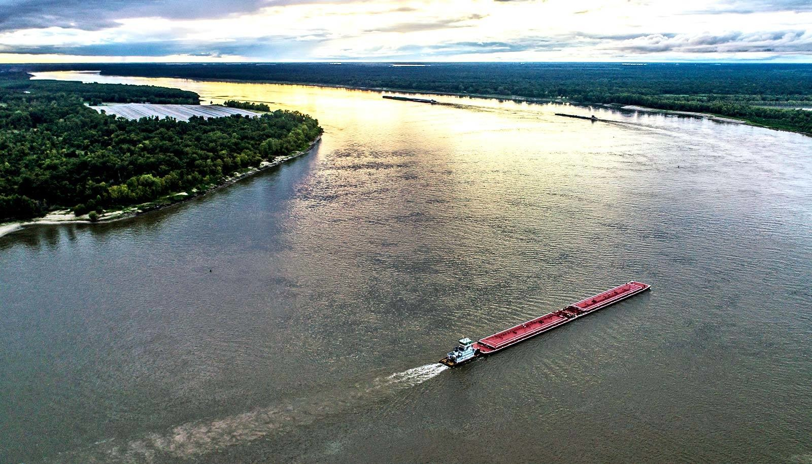 A boat floats down the Mississippi river.