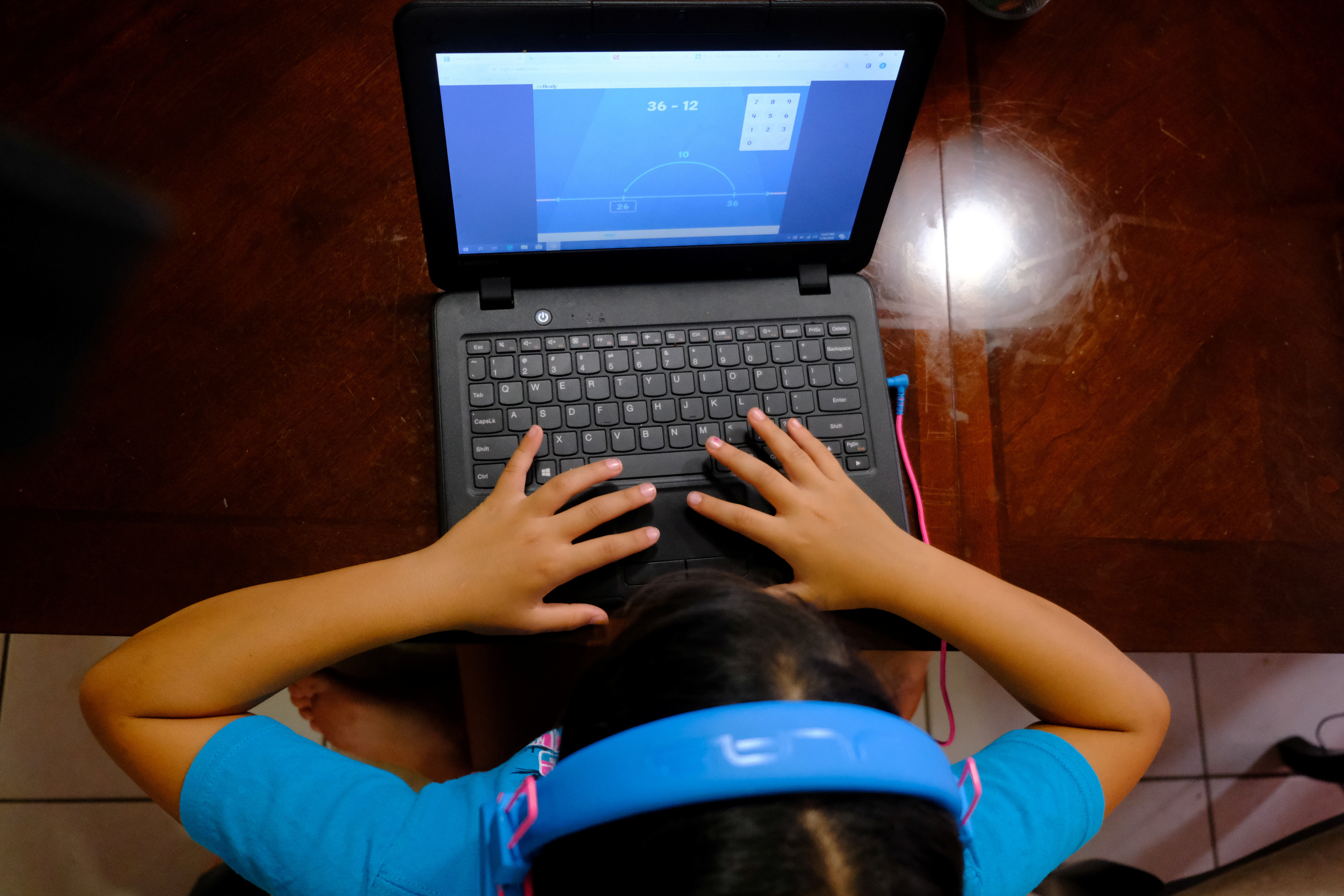 Hazeline Panditaratne completes her math assessments  from her computer in Broward County, Florida, U.S. May 29, 2020. Picture taken May 29, 2020.  REUTERS/Maria Alejandra Cardona - RC211H9CF49Y